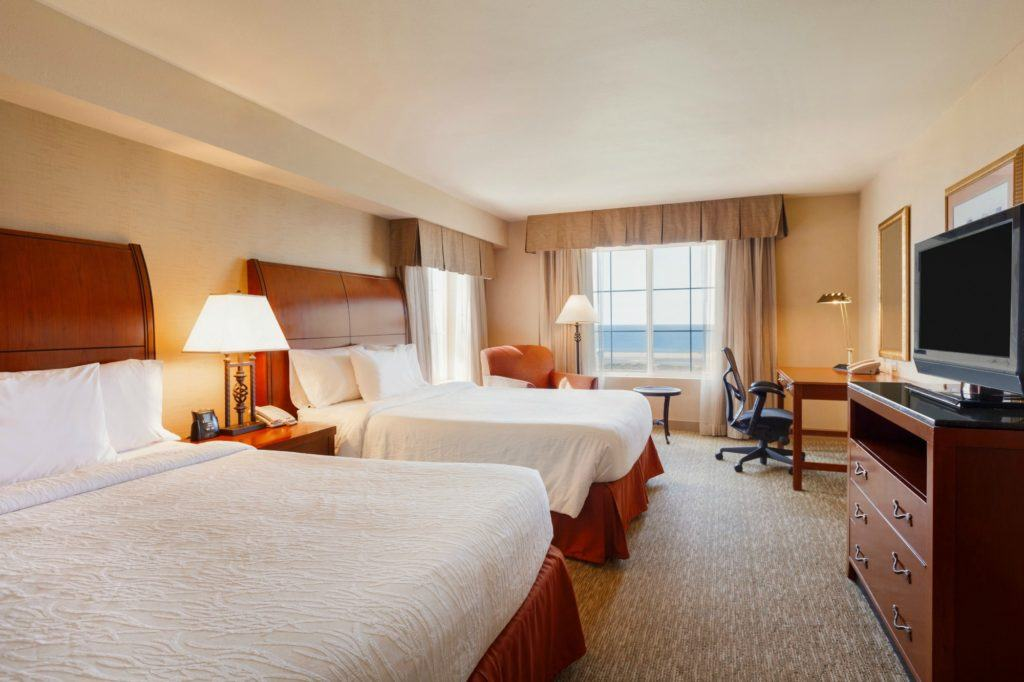 A double Queen room at Hilton Garden Inn Carlsbad Beach, a hotel near LEGOLAND California.