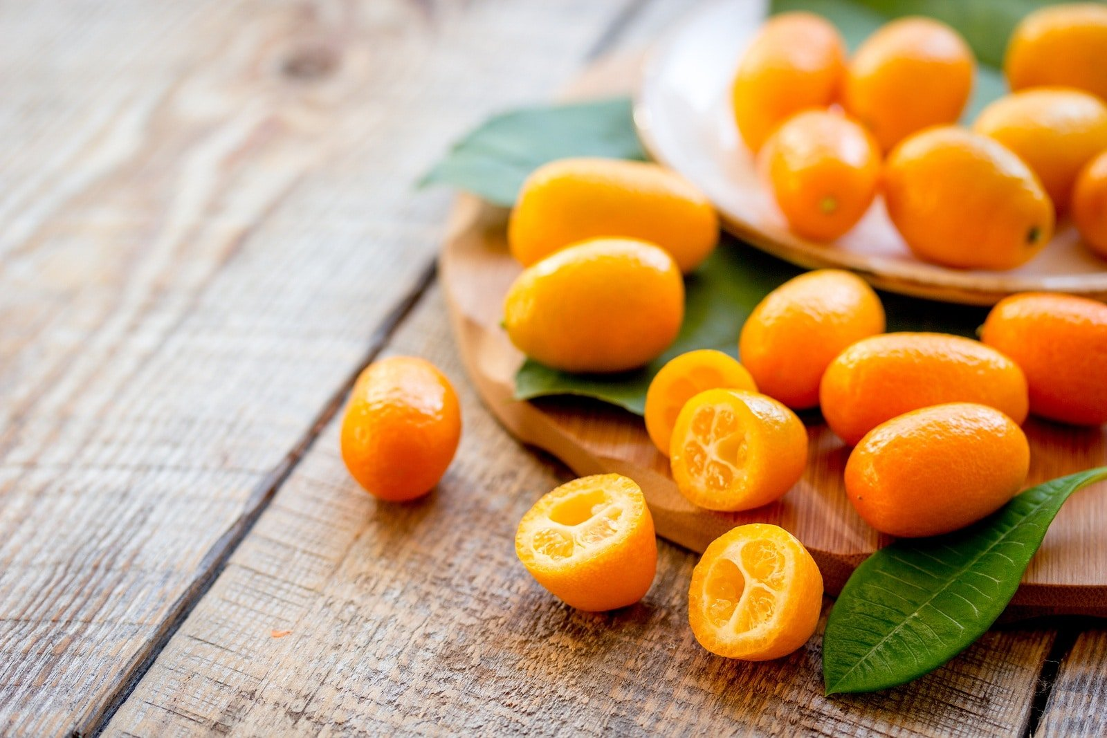 Kumquats are auspicious Asian fruits used as decor for Chinese New Year.