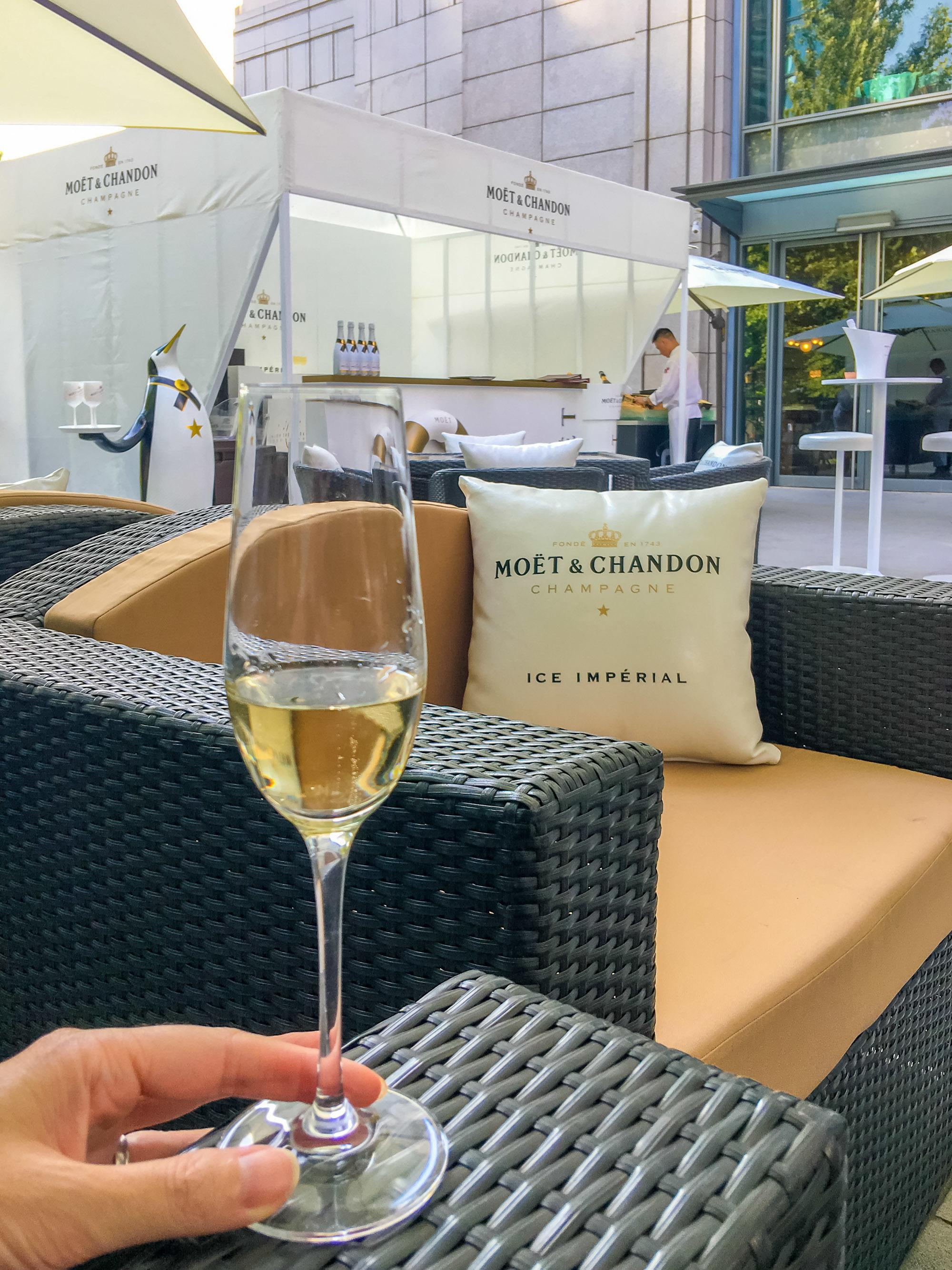 A glass of Moet Chandon on the patio of The Ritz-Carlton, Beijing
