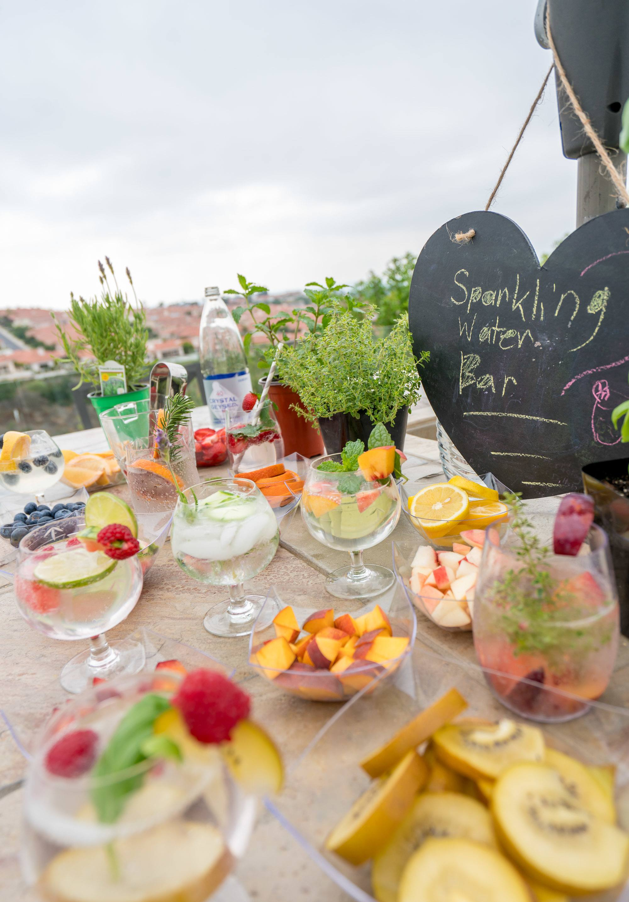 Party ideas: Make a sparkling water bar with fruit and herbs.