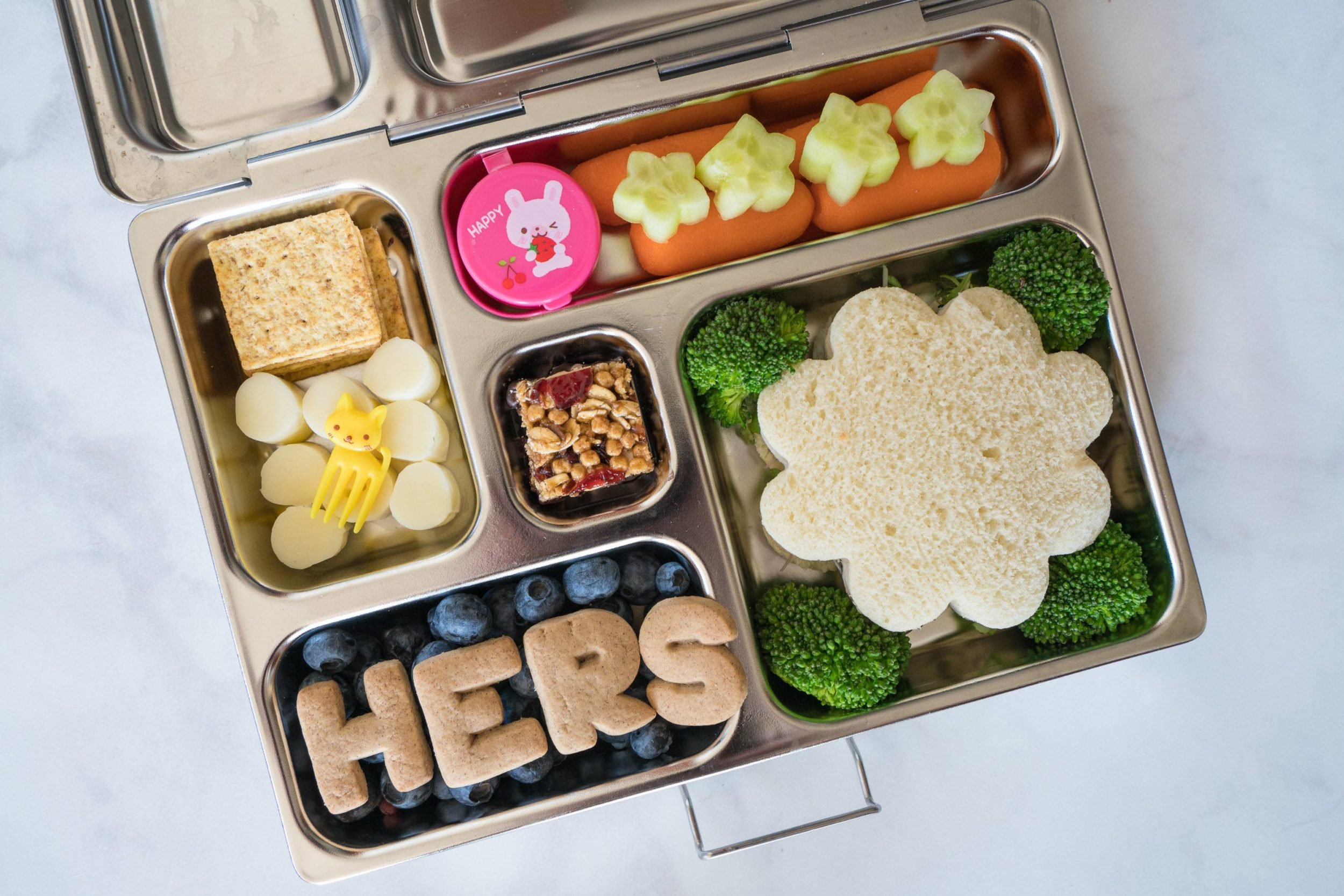 Pack sections of the bento lunch tightly to achieve the right look. Divided containers help!