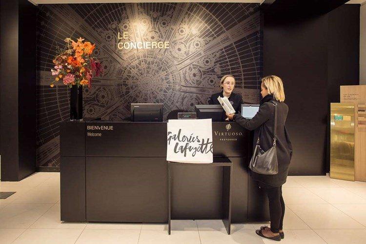 A Galeries Lafayette VIP concierge assists a guest