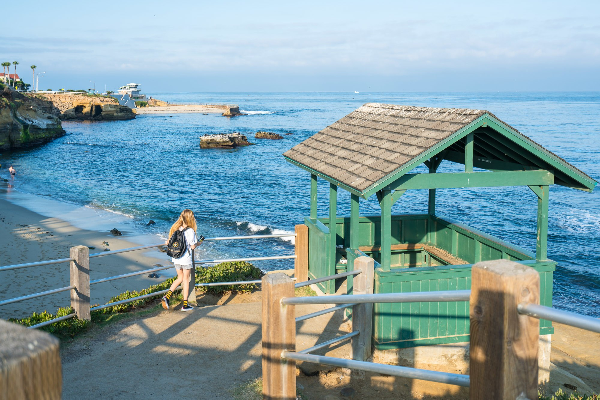 A walk to one of La Jolla's green huts in PF Flyers shoes.