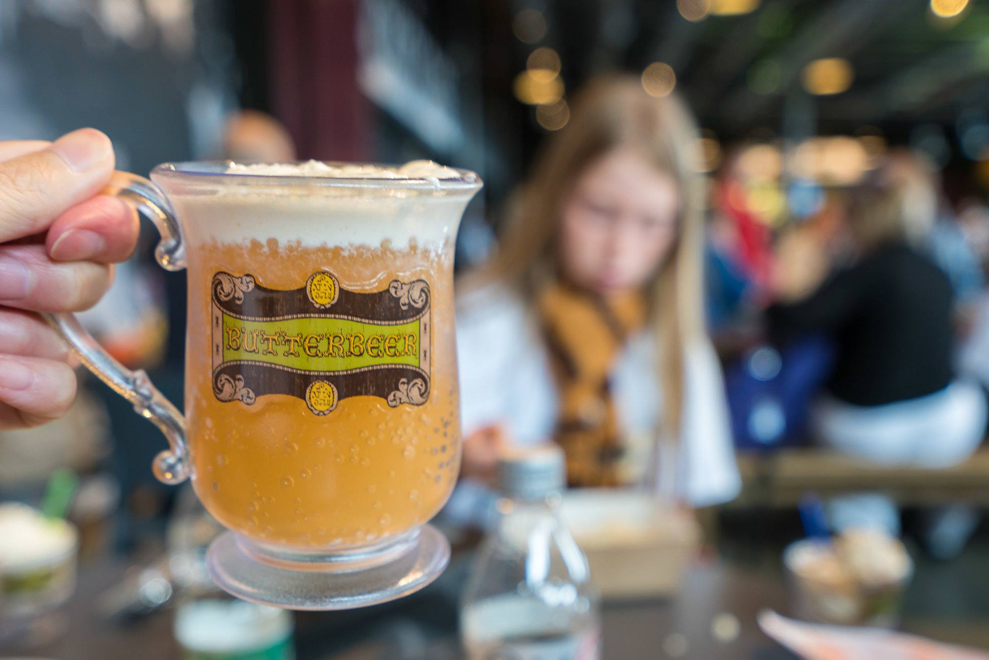Butterbeer sold in a souvenir cup at Warner Bros. Studio Tour London.