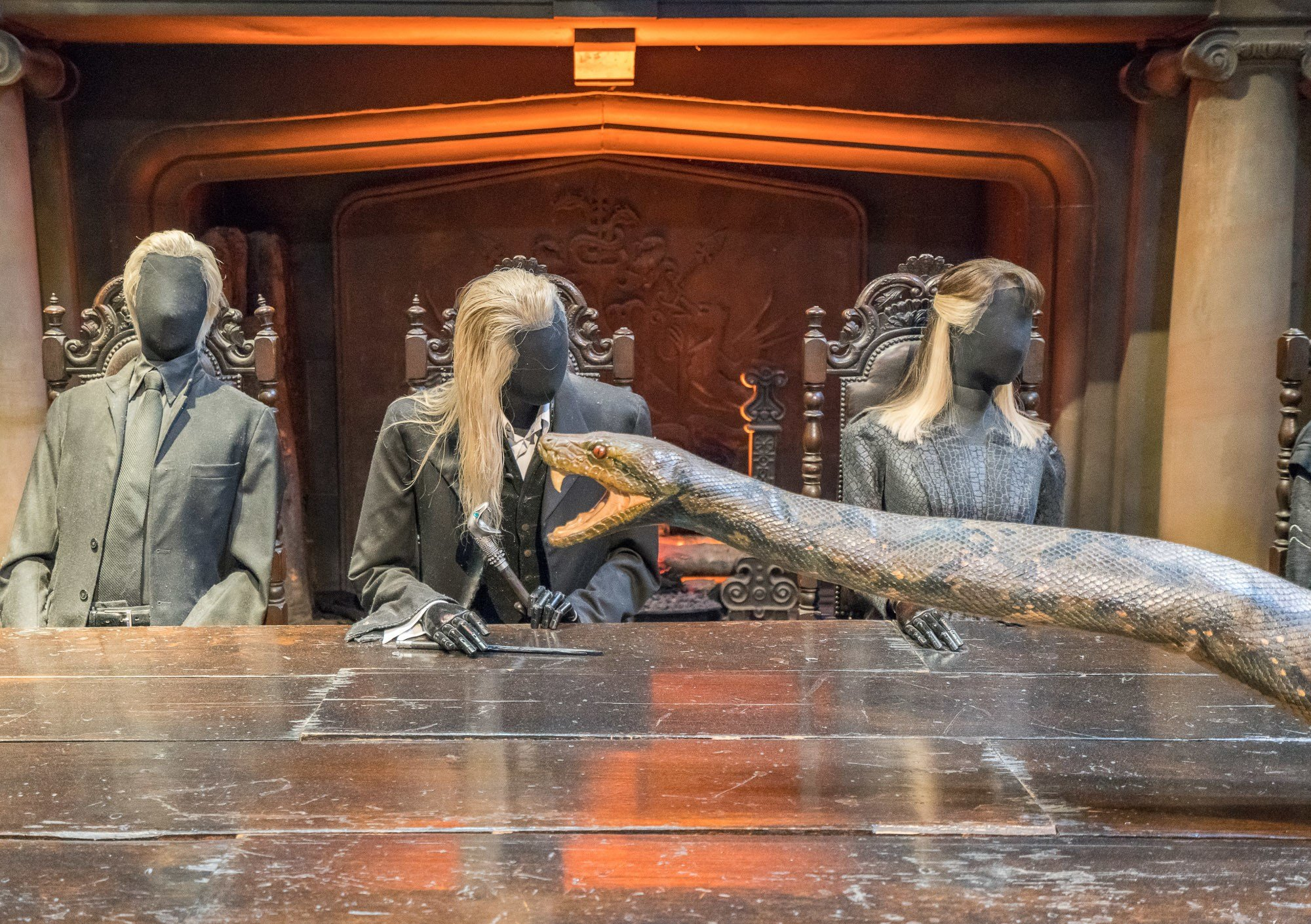 A scene in a Harry Potter movie where Nagini the snake crawls on the table, reenacted at the Warner Bros. Studio Tour London.
