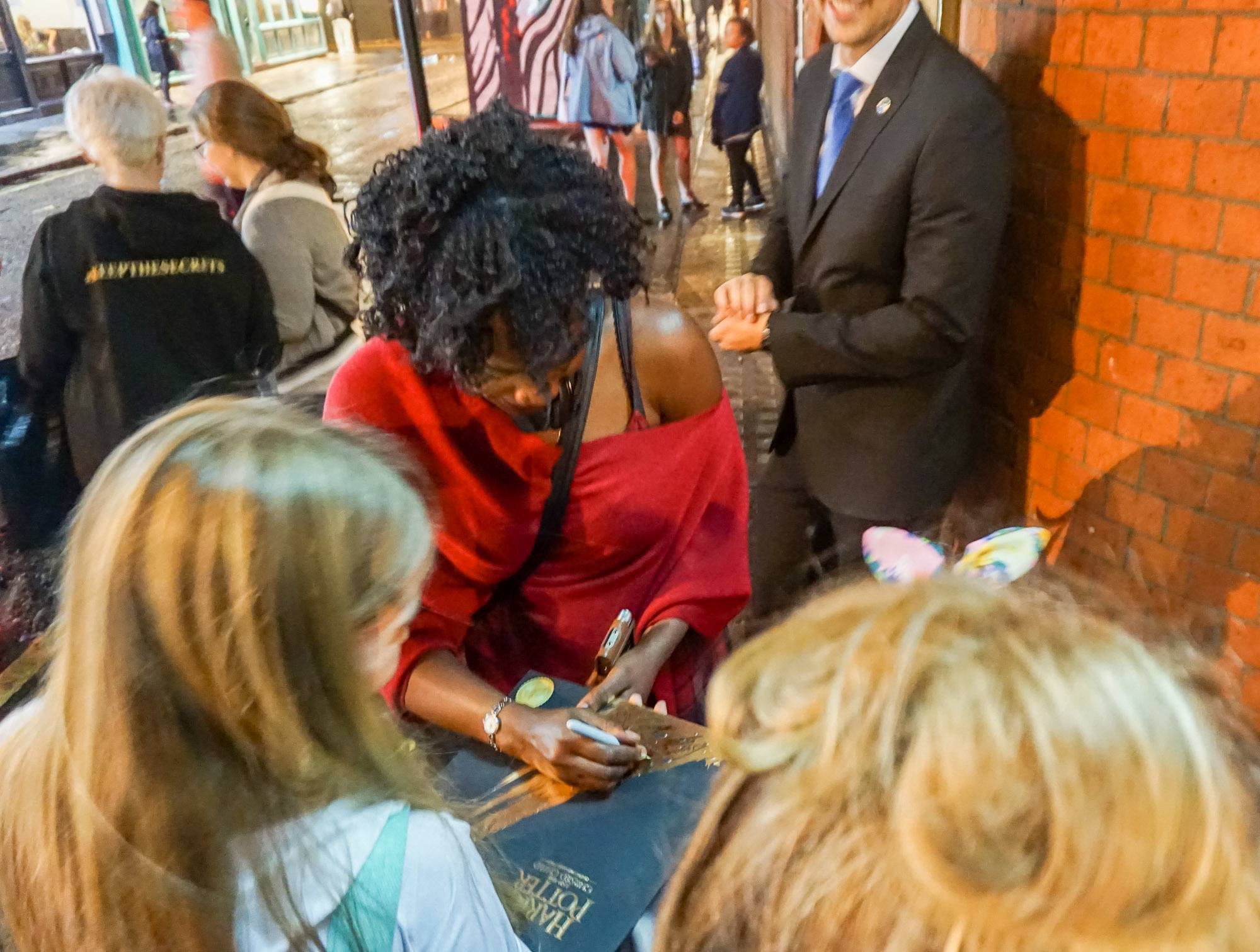 Actors sign autographs near the backstage door of the Cursed Child play in London.