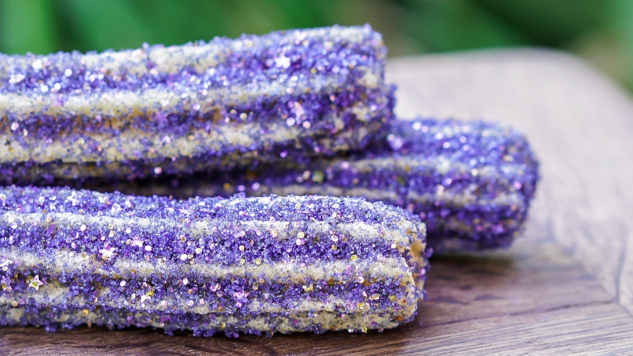 Purple Disneyland Halloween churros will be sold at snack carts around the park.