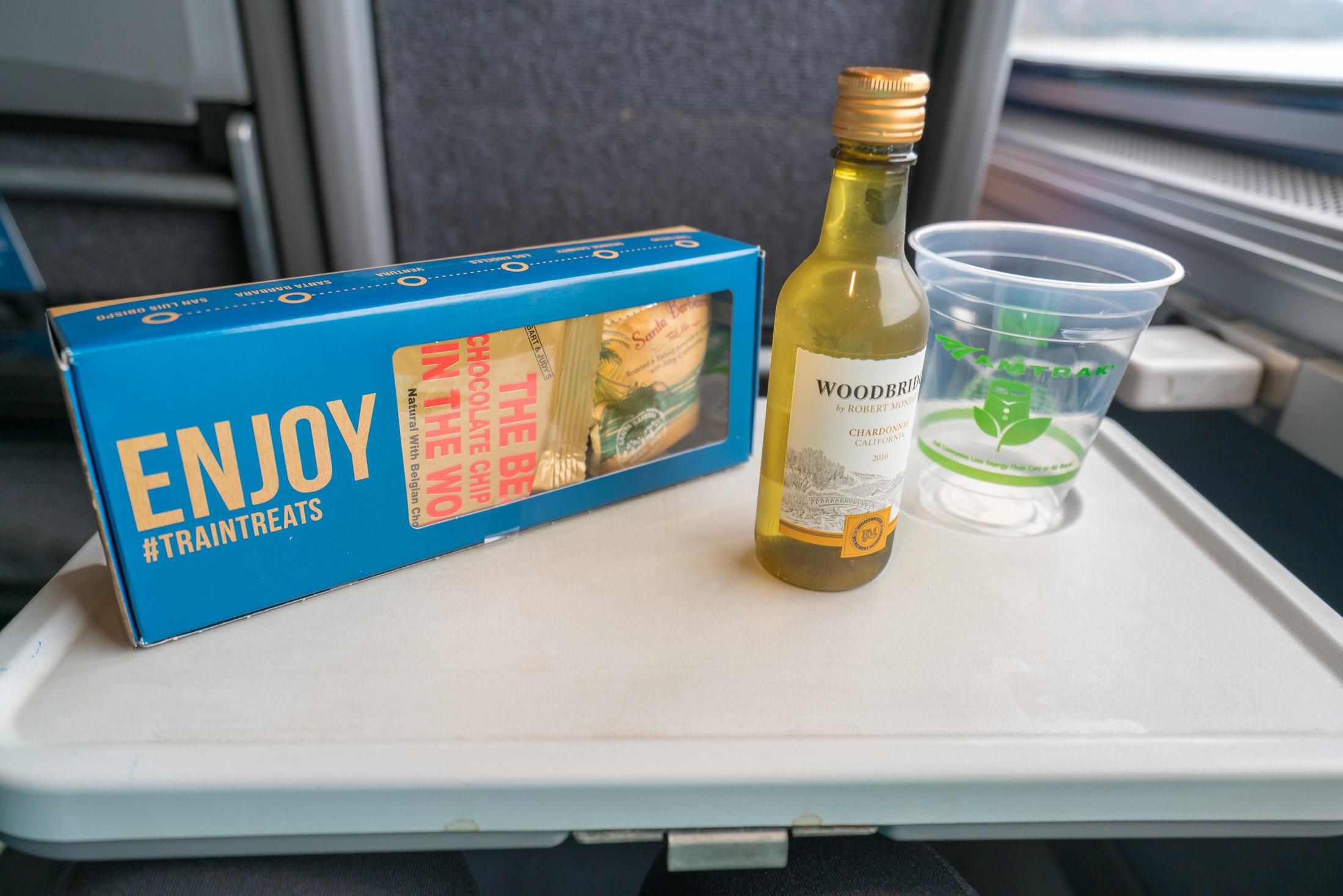 Wine and a snack pack given out in Amtrak business class on the Pacific Surfliner train.