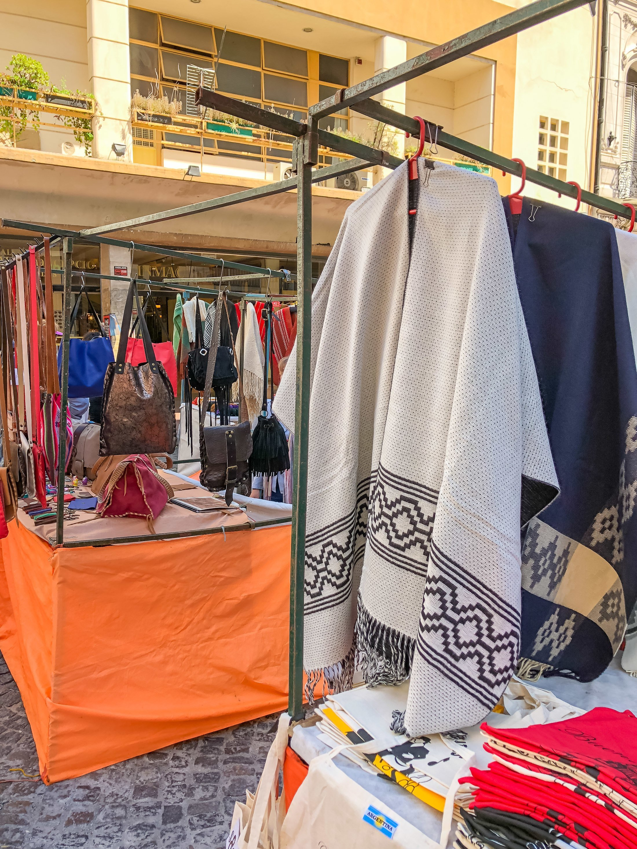 Leather goods and ponchos at the San Telmo Fair in Buenos Aires.