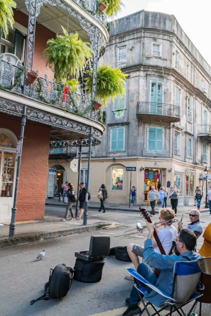 Musicians entertain while shoppers browse the French Quarter in New Orleans.