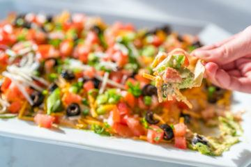 This easy 7 layer dip recipe will be the hit of your party.