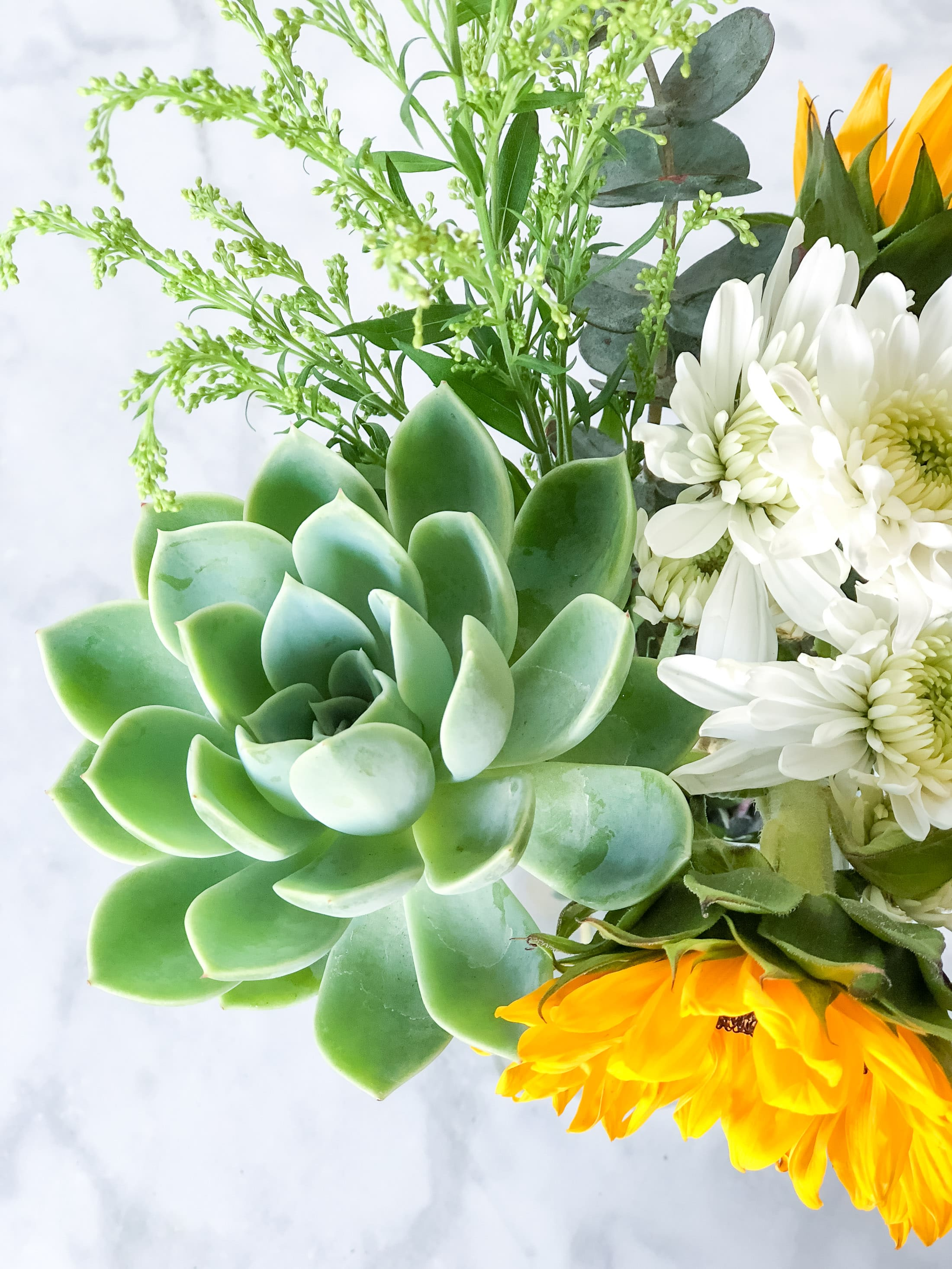 A bouquet of sunflowers and succulents