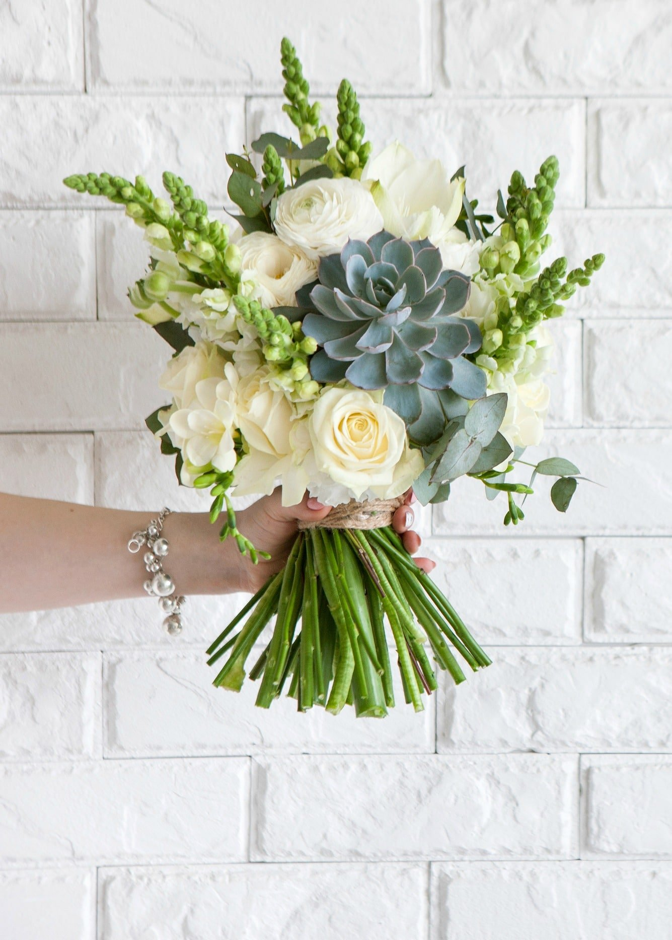 Succulent bouquet with white roses