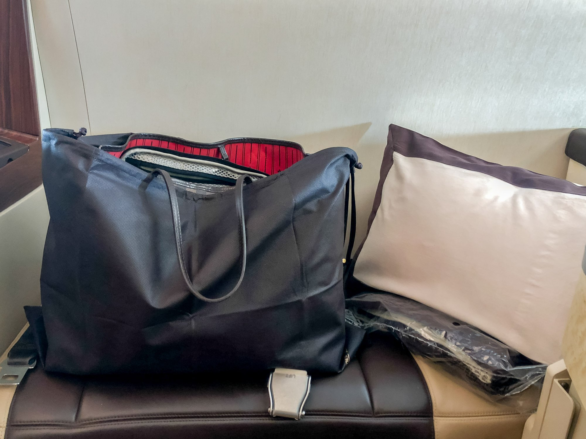 Handbag cover provided in Singapore Airlines first class suite.