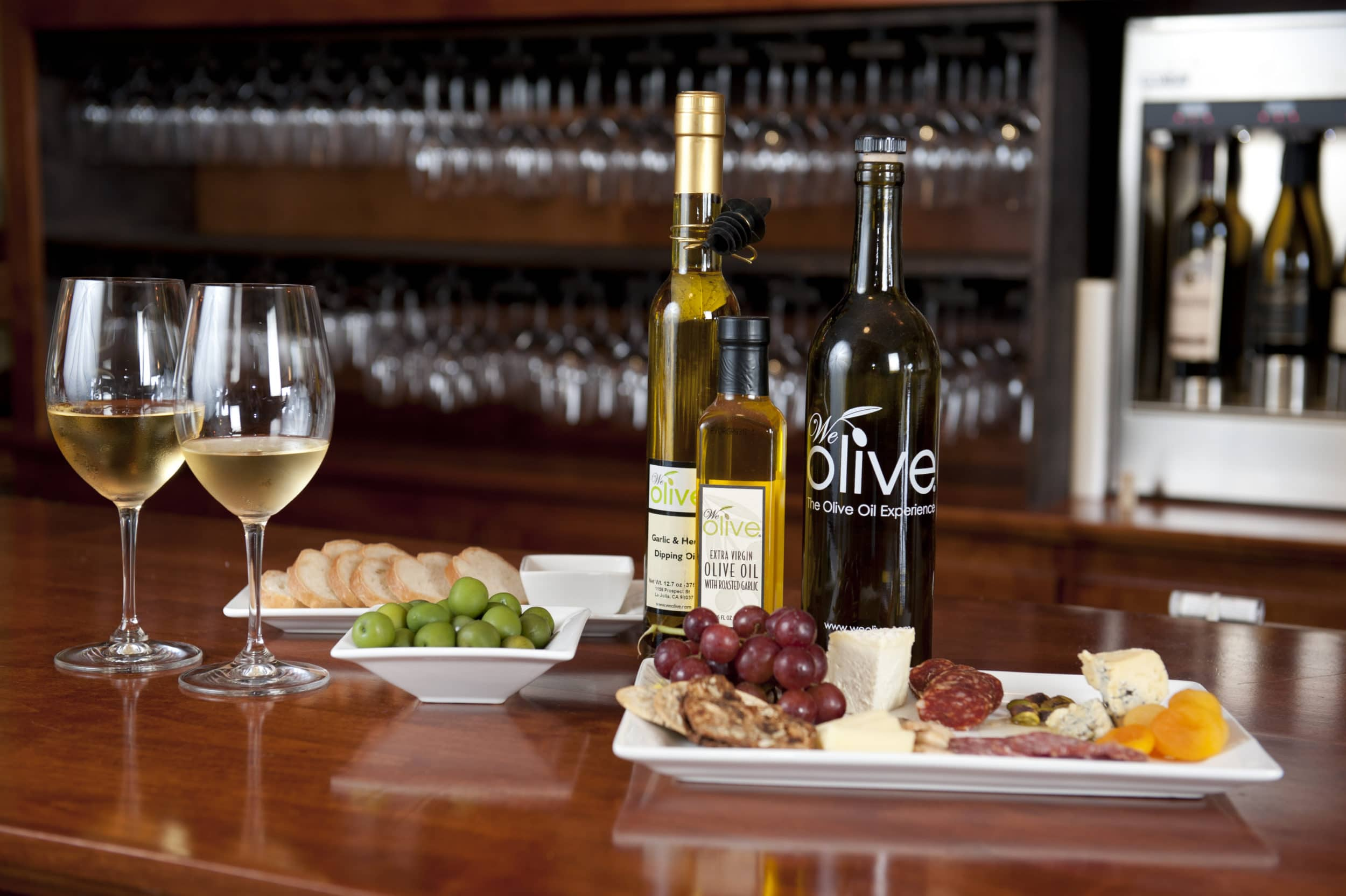 We Olive is great for La Jolla shopping for culinary gifts but the happy hour charcuterie plate and wine pictured here is another reason to go.
