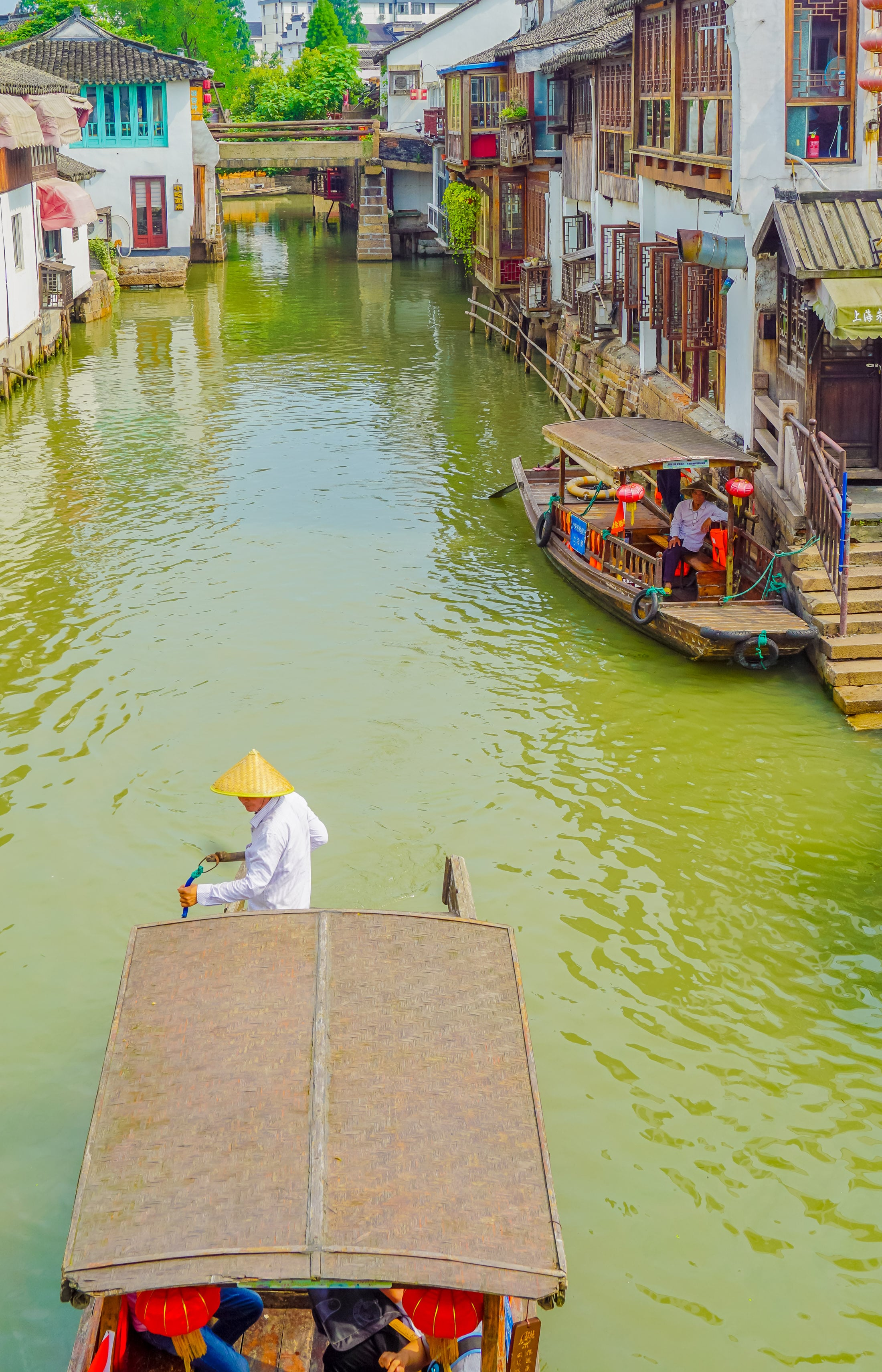 Take a boat ride at Zhujiajiao water town outside of Shanghai