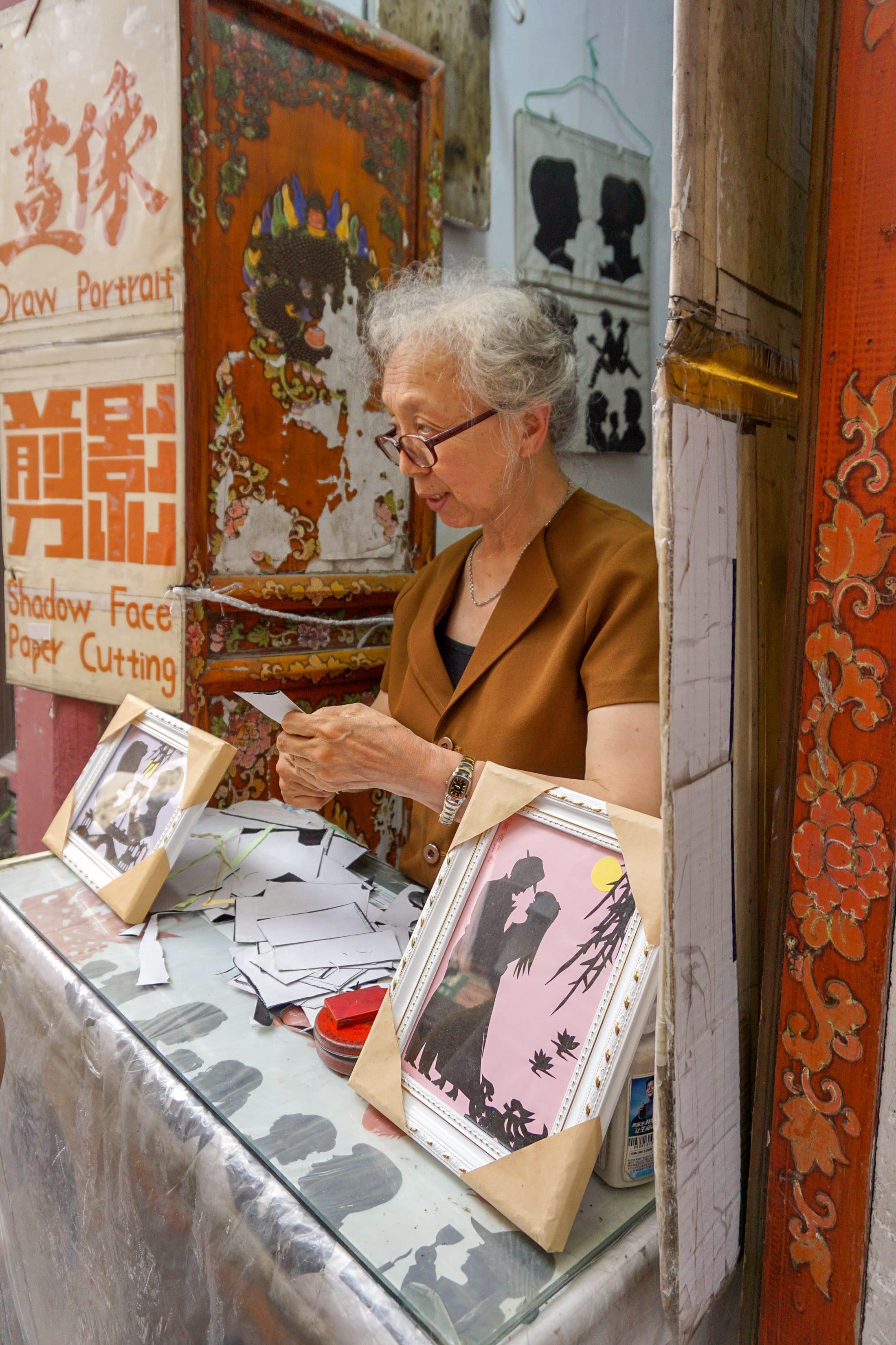 A paper artist at Zhujiajiao water town near Shanghai