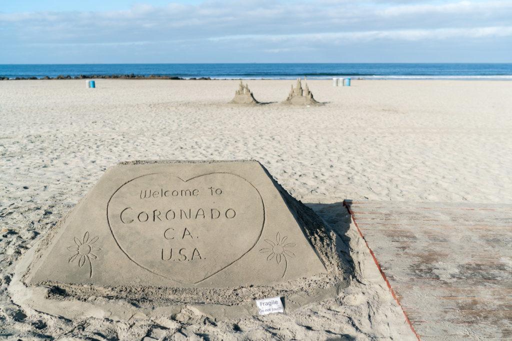Kids love the sandcastle man in front of Hotel Del Coronado