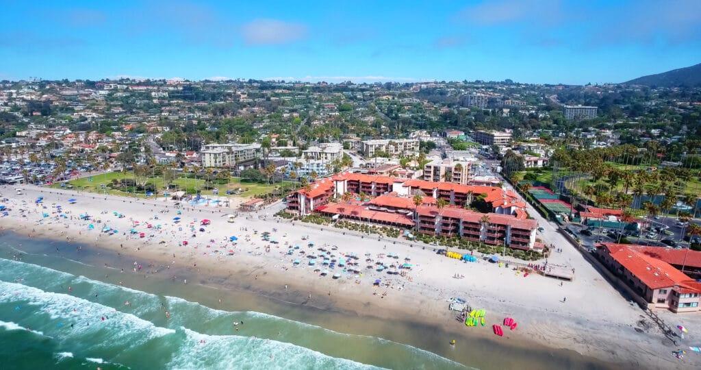 Aerial view of beachfront La Jolla Shores Hotel and La Jolla Shores Beach.