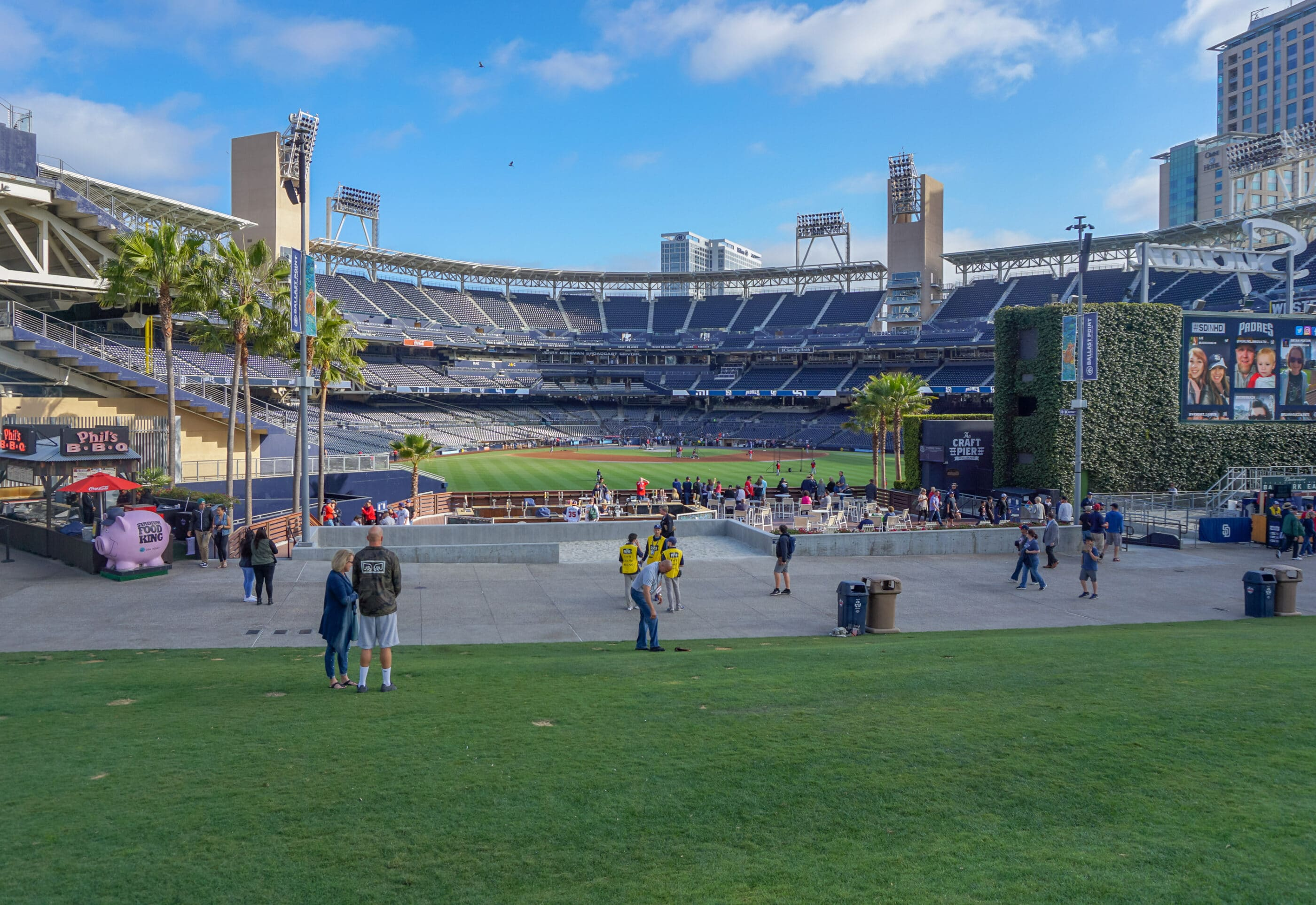 People enjoy PETCO Park before a Padres game in San Diego.