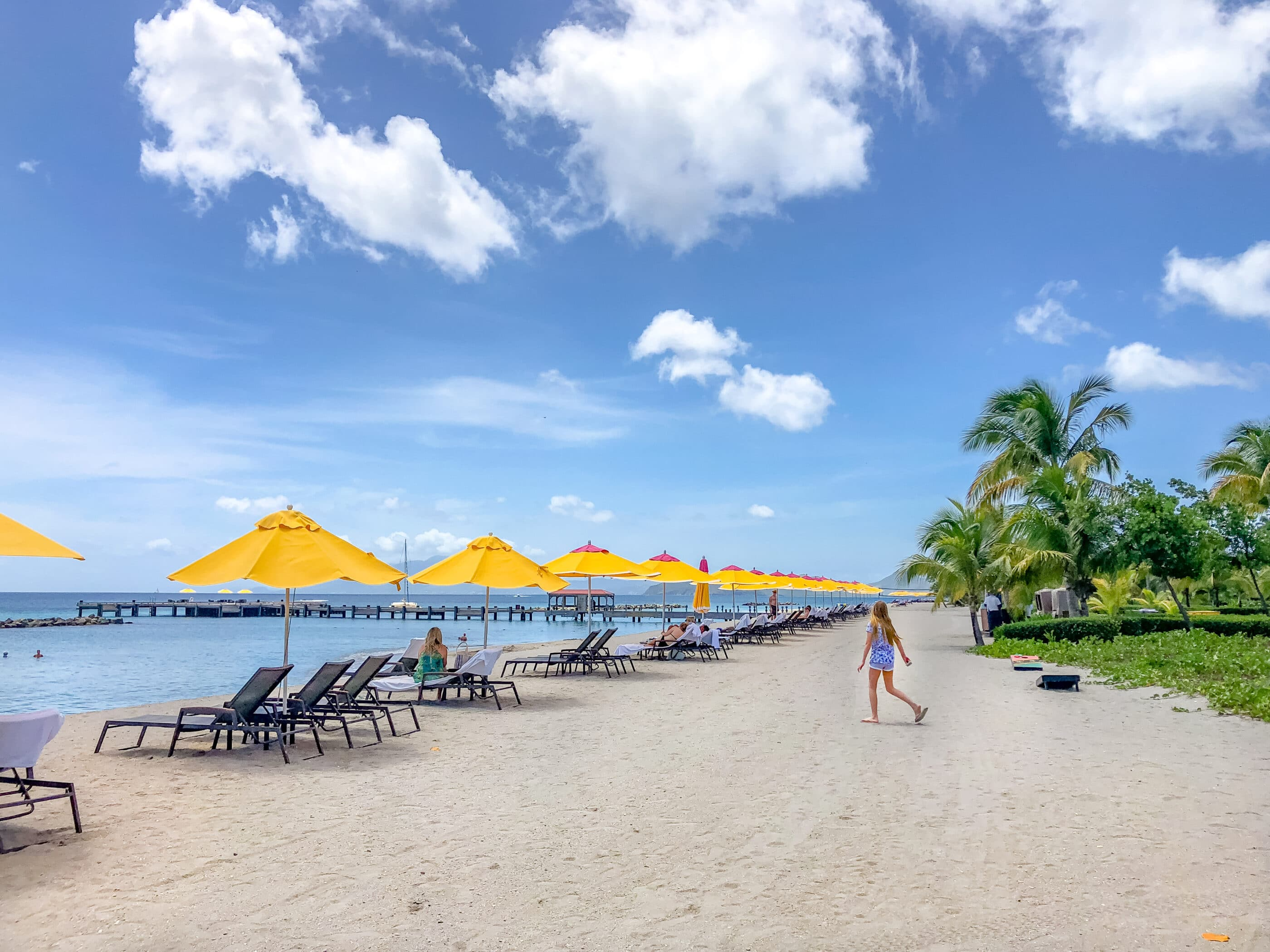 My daughter walks down the beach in front of Four Seasons Nevis