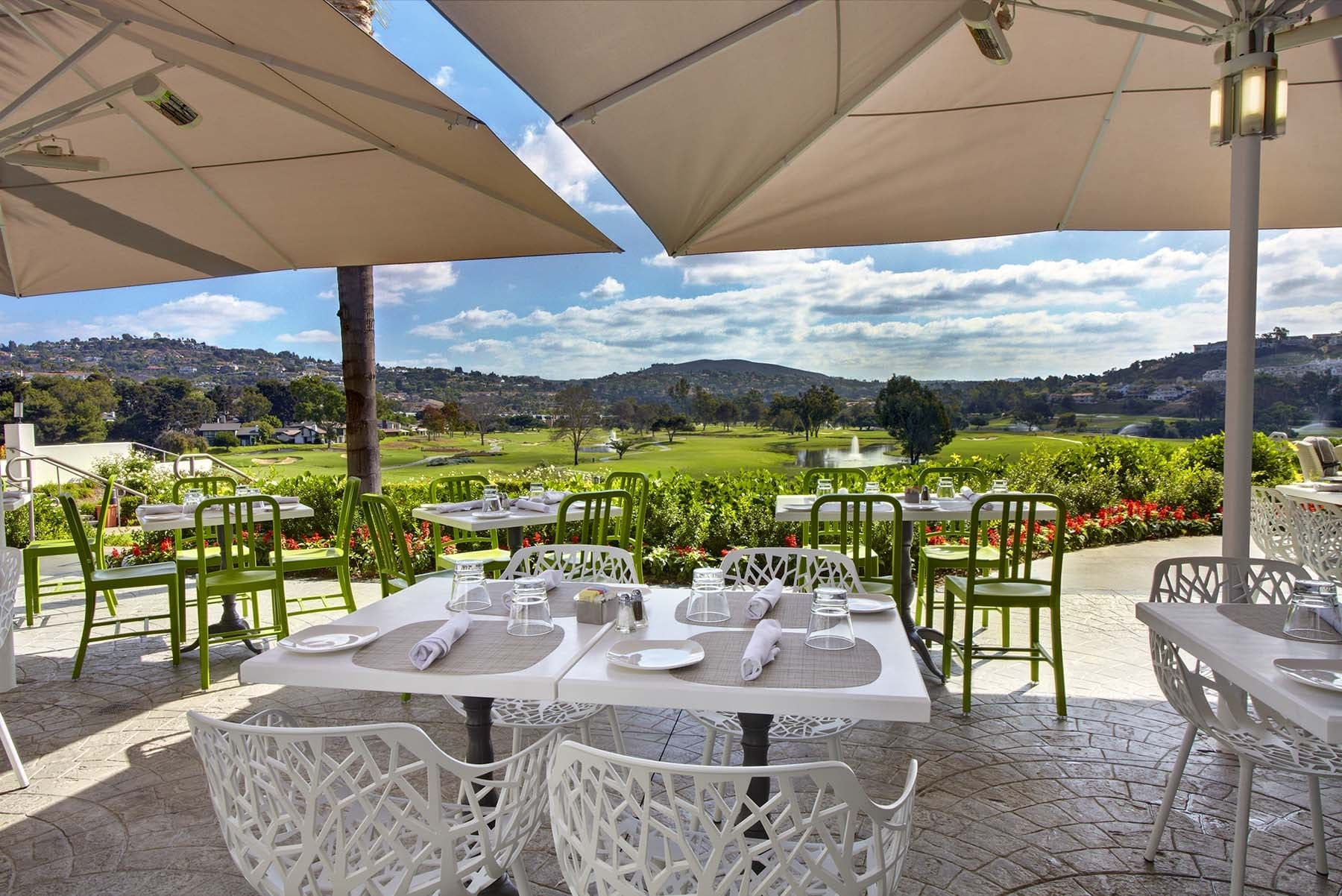 Omni La Costa's VUE Restaurant outdoor patio overlooking the golf course.