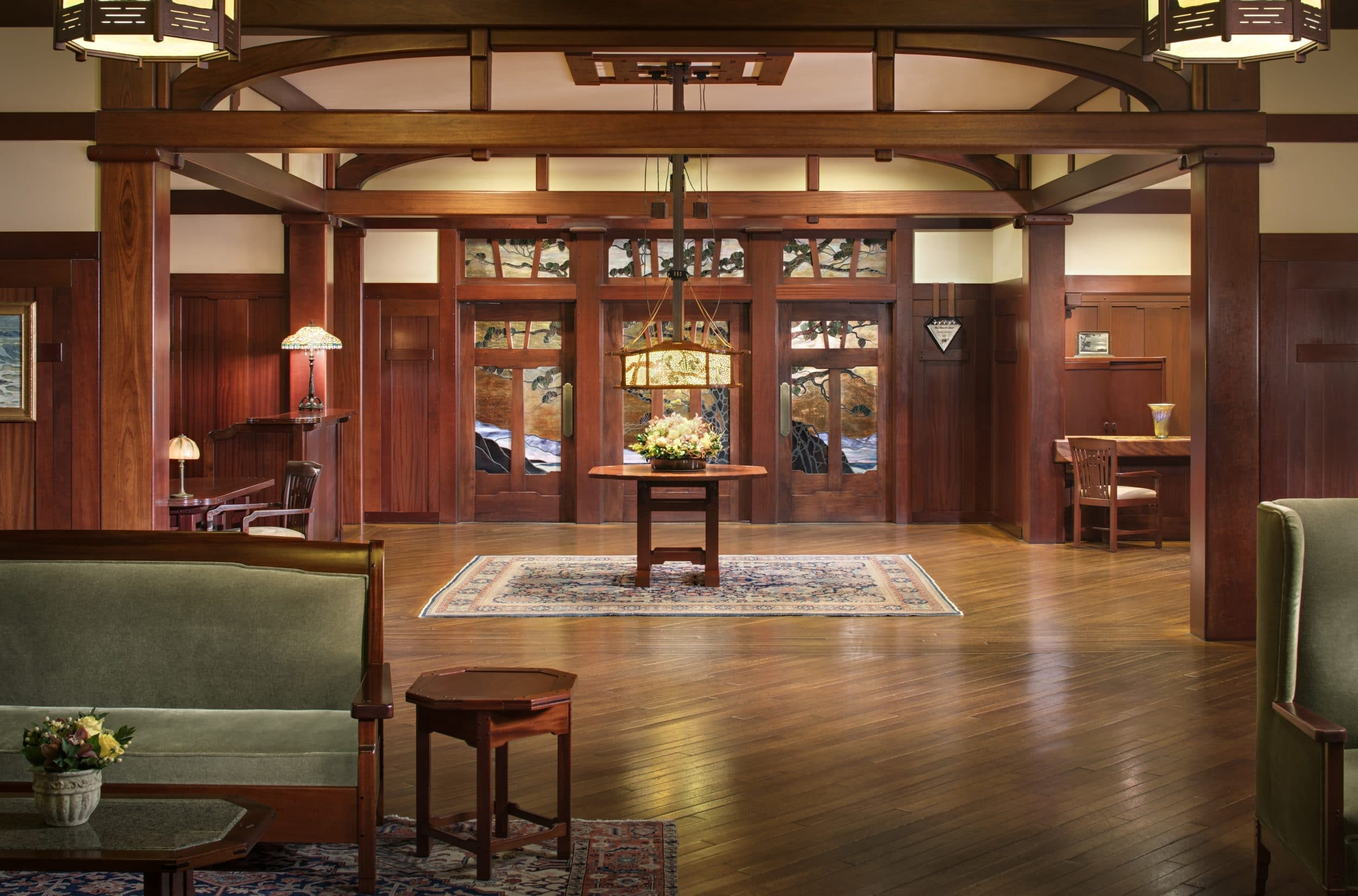 The Lodge at Torrey Pines Craftsman-style lobby with wood beam arches and stained glass.
