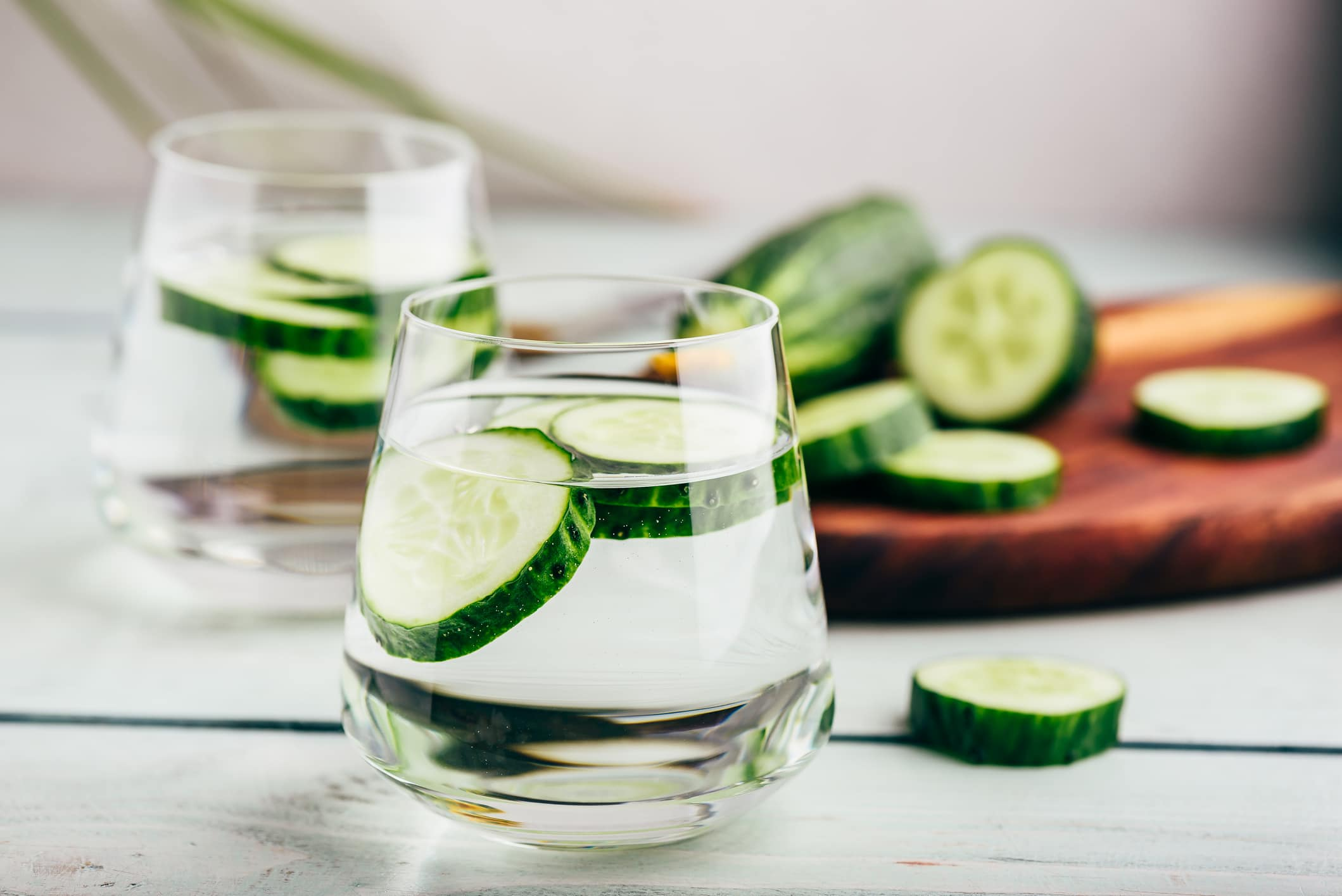 Water with cucumber in it illustrating health benefits of cucumber water.