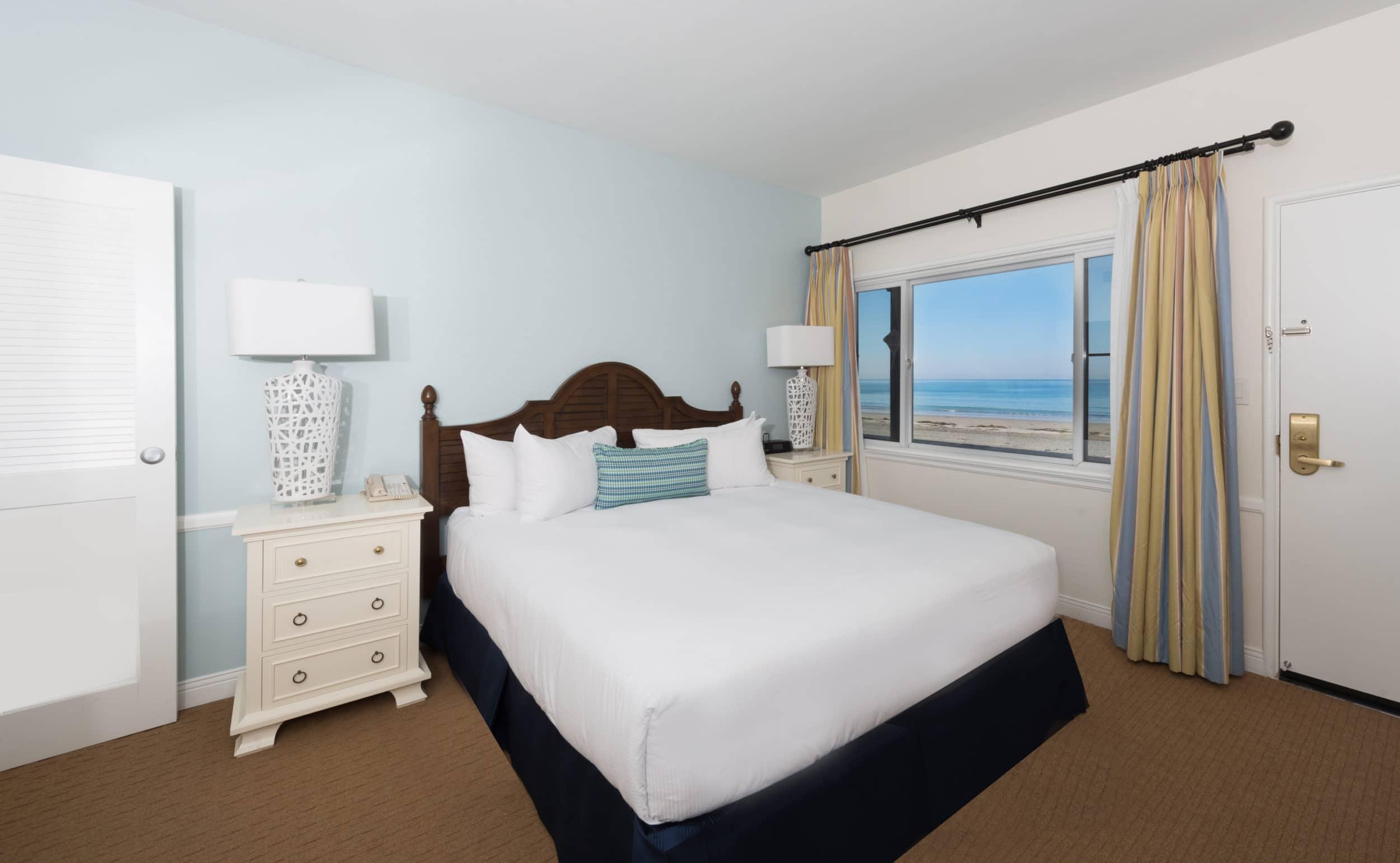 Guest bedroom interior in coastal colors at La Jolla Beach and Tennis Club