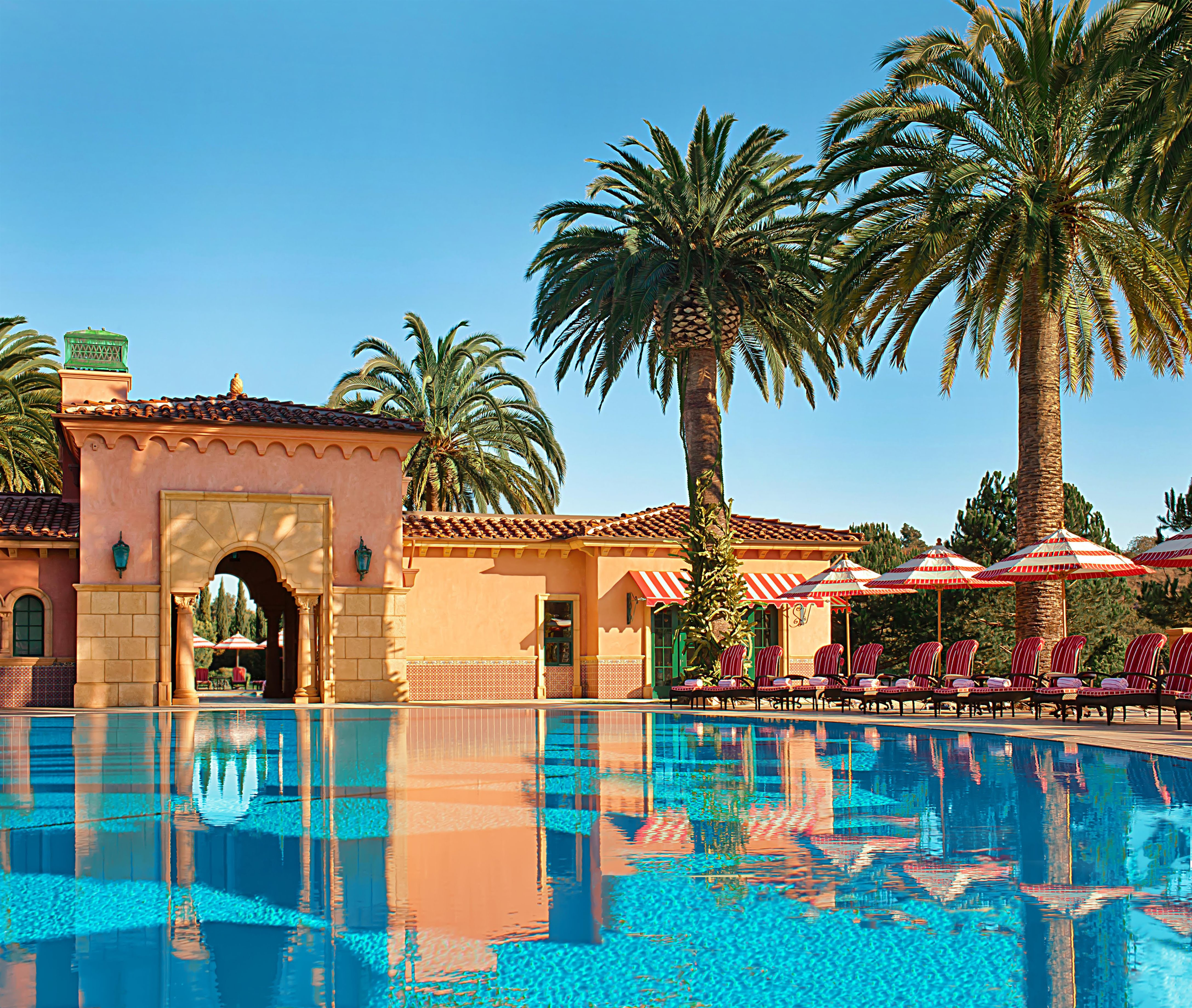 View of the main pool area with palm trees at Fairmont Grand Del Mar, one of the best resorts in San Diego.