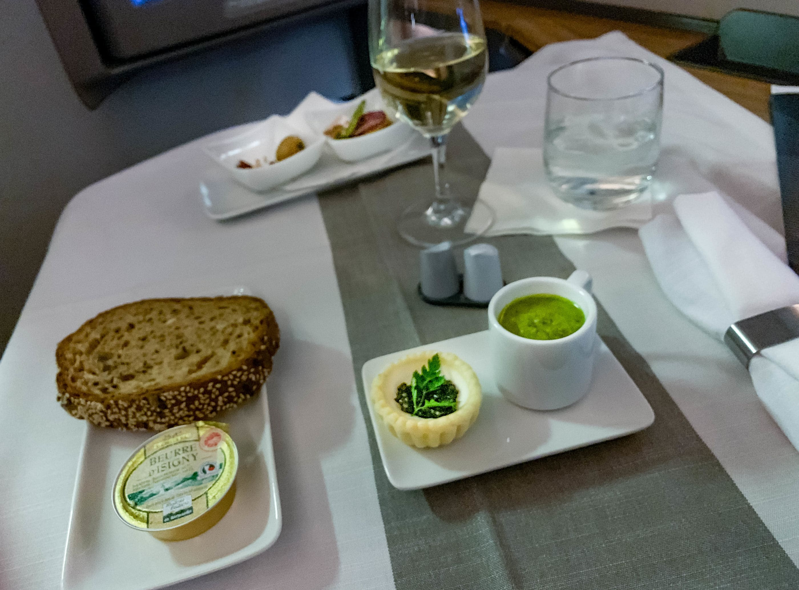 Tart with caviar and kale soup on American Airlines flight 182 first class from HKG-LAX