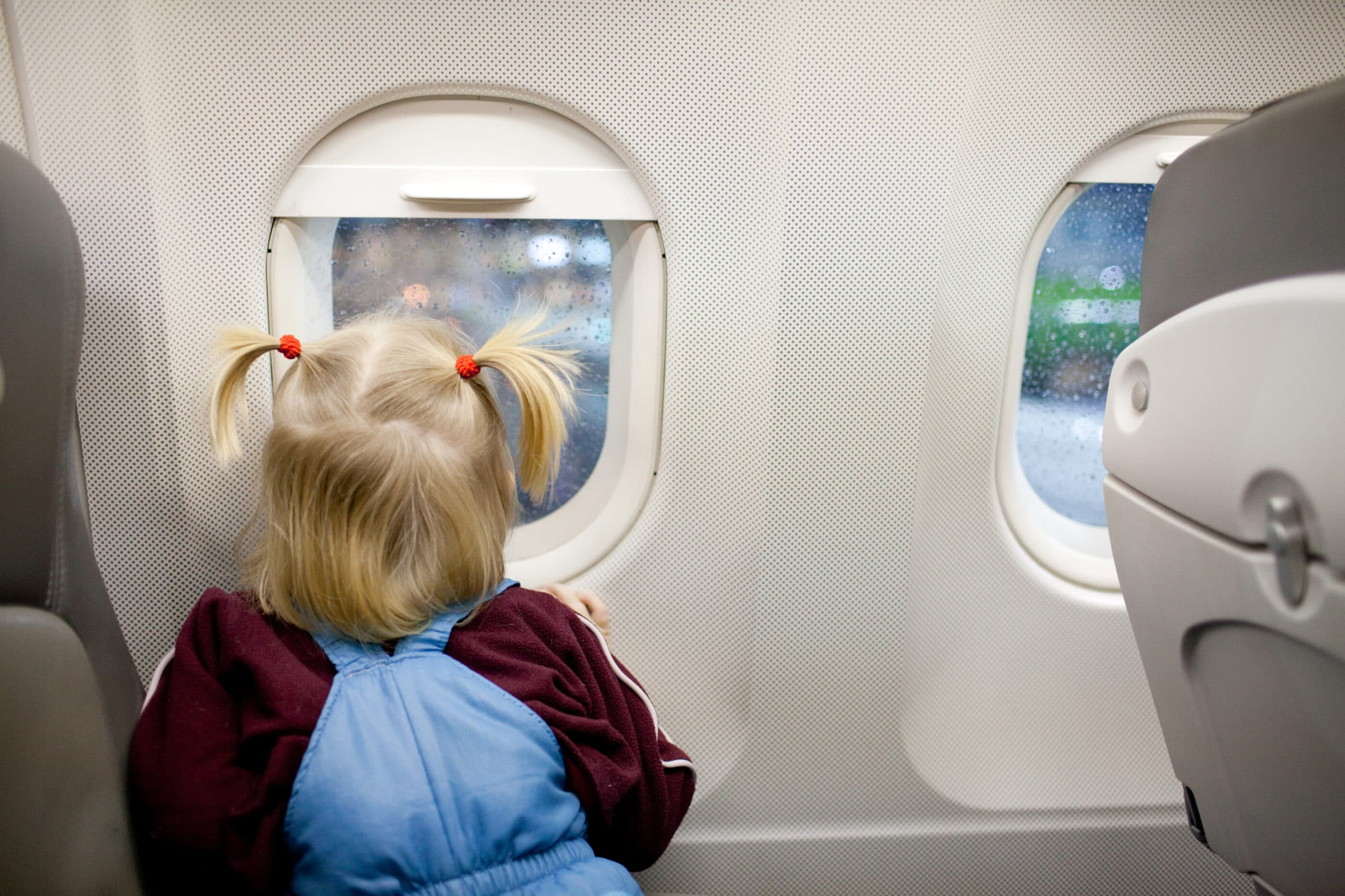 Child looking out of an airplane window