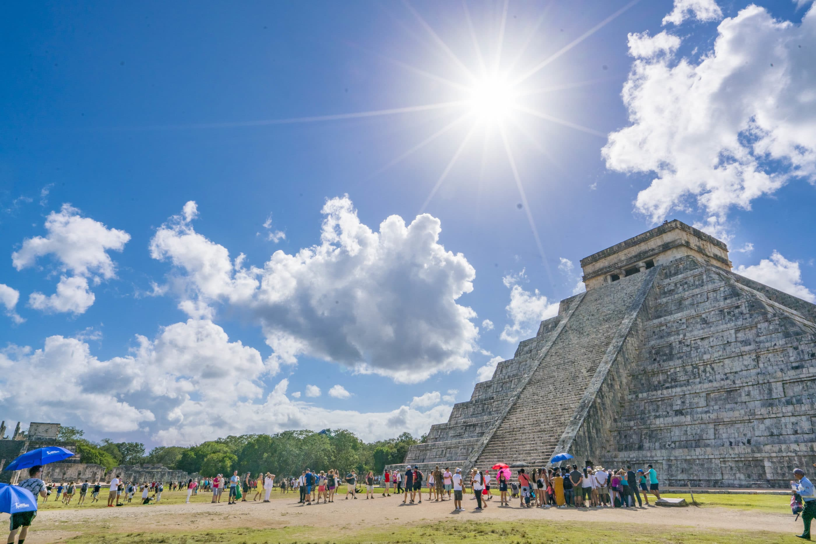 Main pyramid at Chichen-Itza under sunshine and blue skies