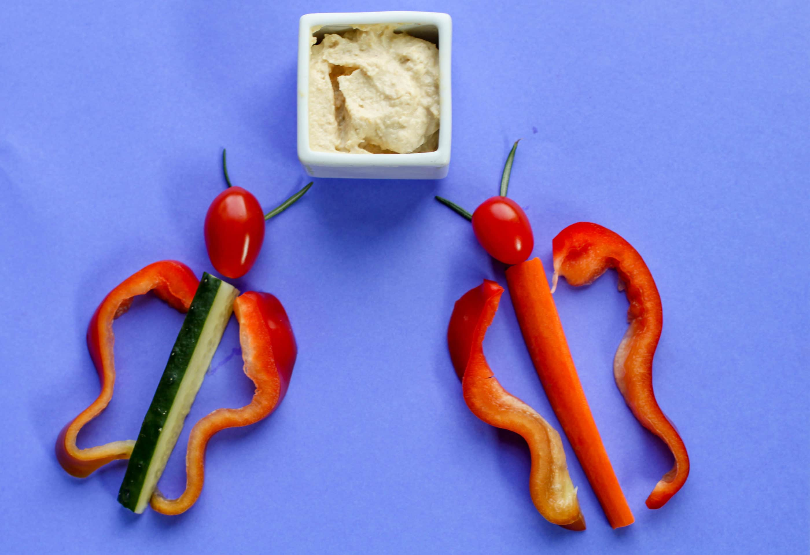 Vegetable shaped butterflies made with bell pepper, cucumber, tomato and rosemary.