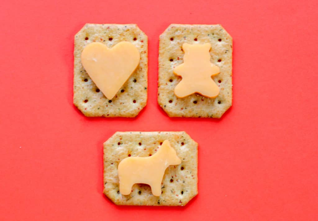 Cheese cut into shapes on crackers