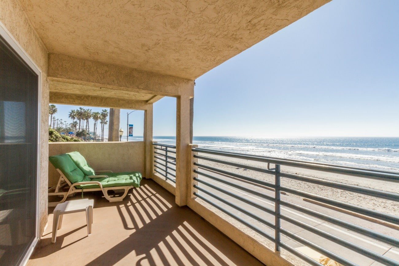 Lounge chair on a deck overlooking the Oceanside beach.