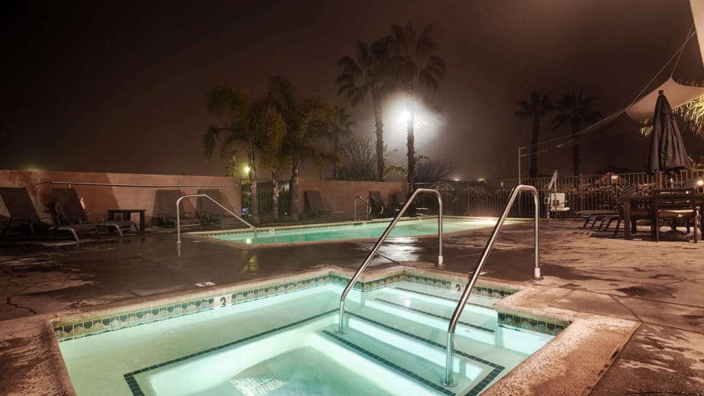 Swimming pool and jacuzzi at night