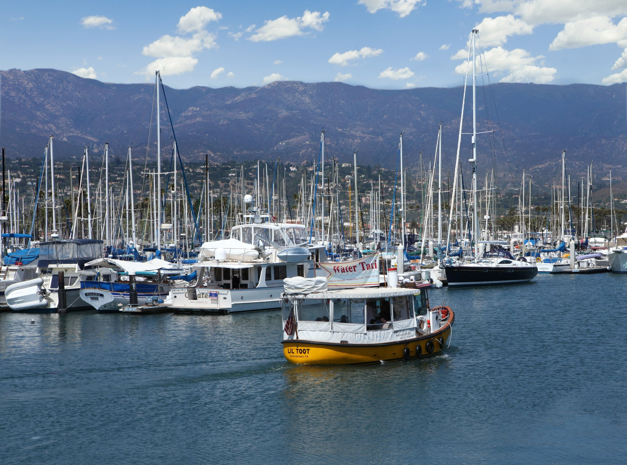 The Lil' Toot Water Taxi sailing in Santa Barbara harbor.
