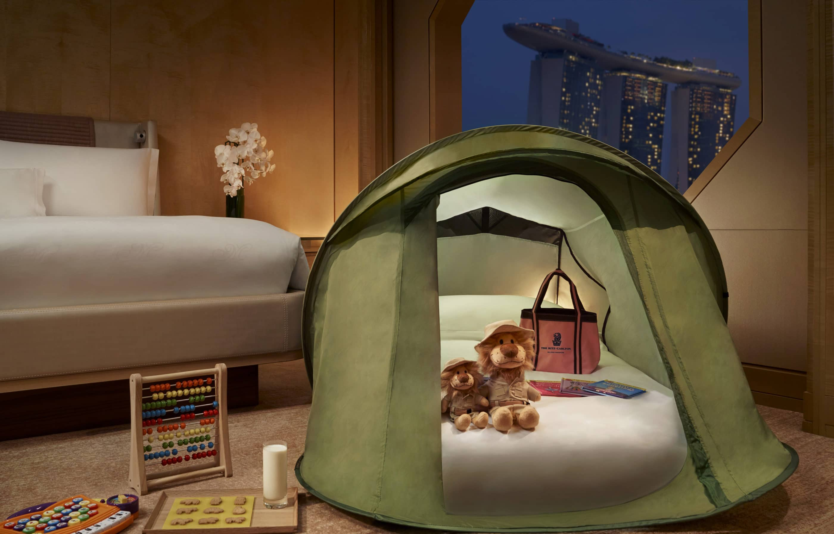 A Ritz Kids pop-up tend with stuffed animals and a small mattress inside for small kids to sleep in.
