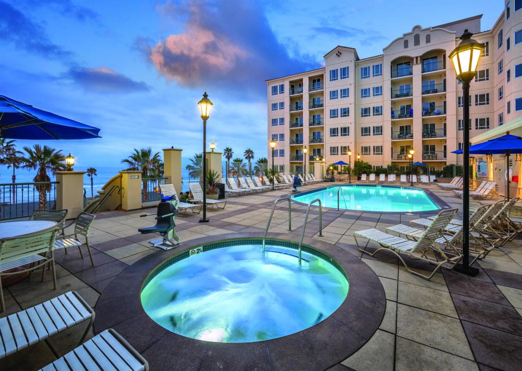 Pool deck with ocean view at Wyndham Oceanside Pier Resort