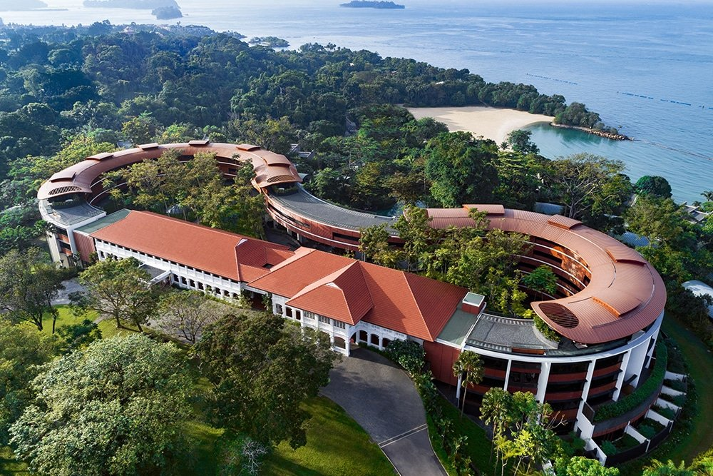 An aerial view of Capella hotel Singapore overlooking the South China Sea on Sentosa Island.