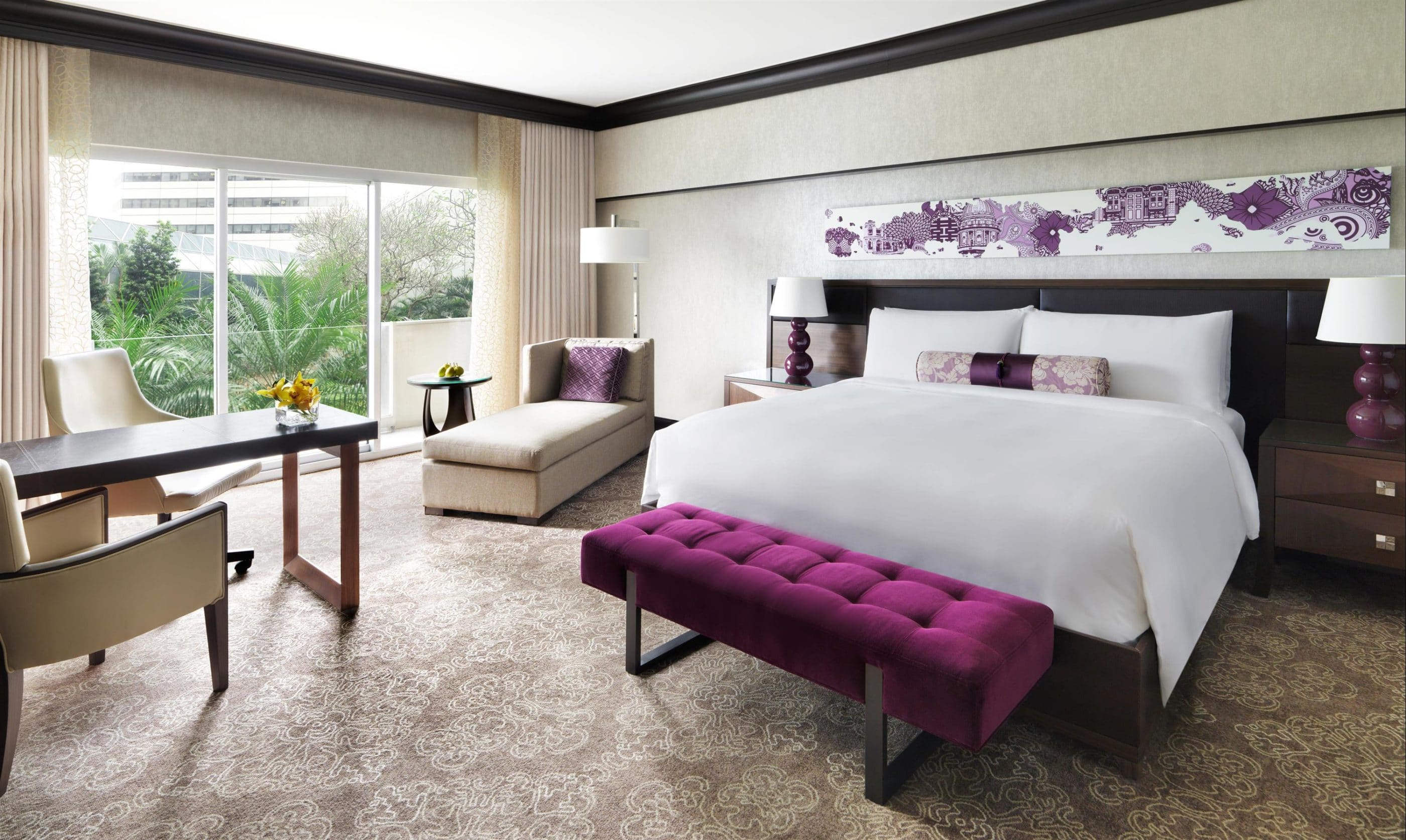 Premier room interior with neutral decor and purple pillow, art, and bench accents.