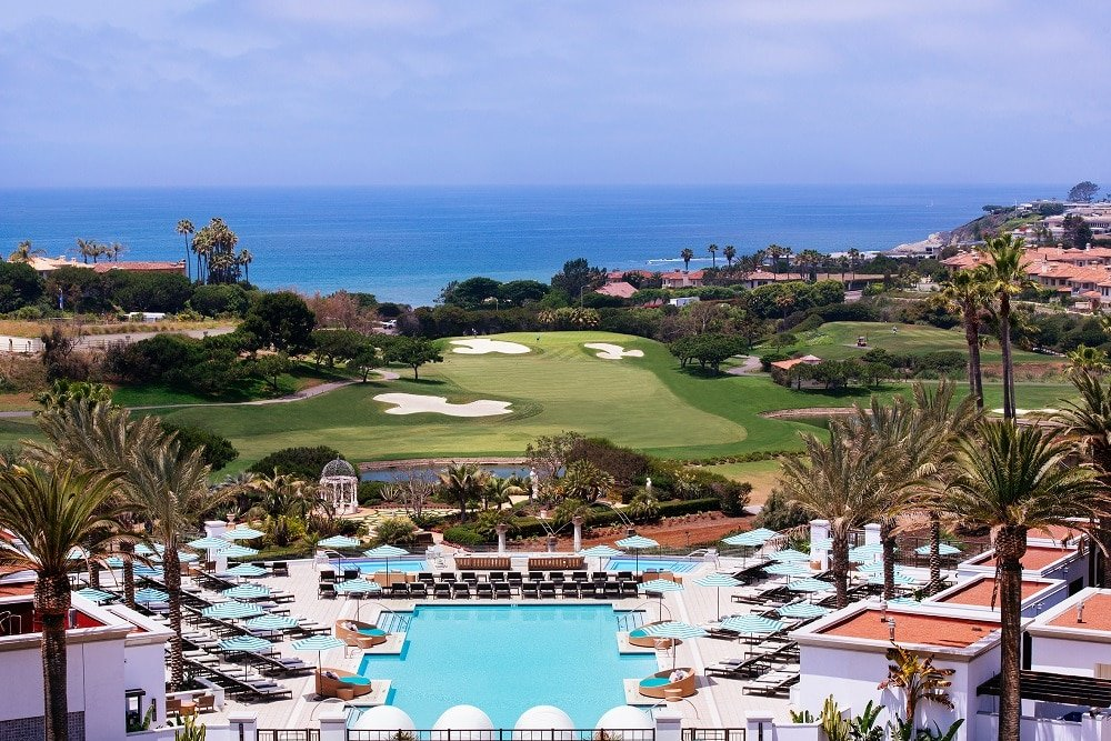 View from the resort over the main pool and golf course to the ocean.