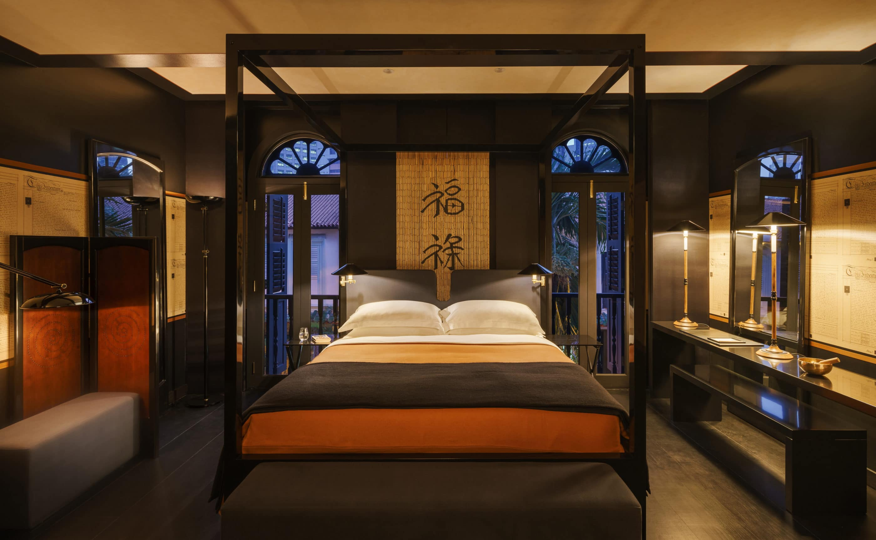 The Opium room features dark wood furnishings and walls with hints of rust-color.