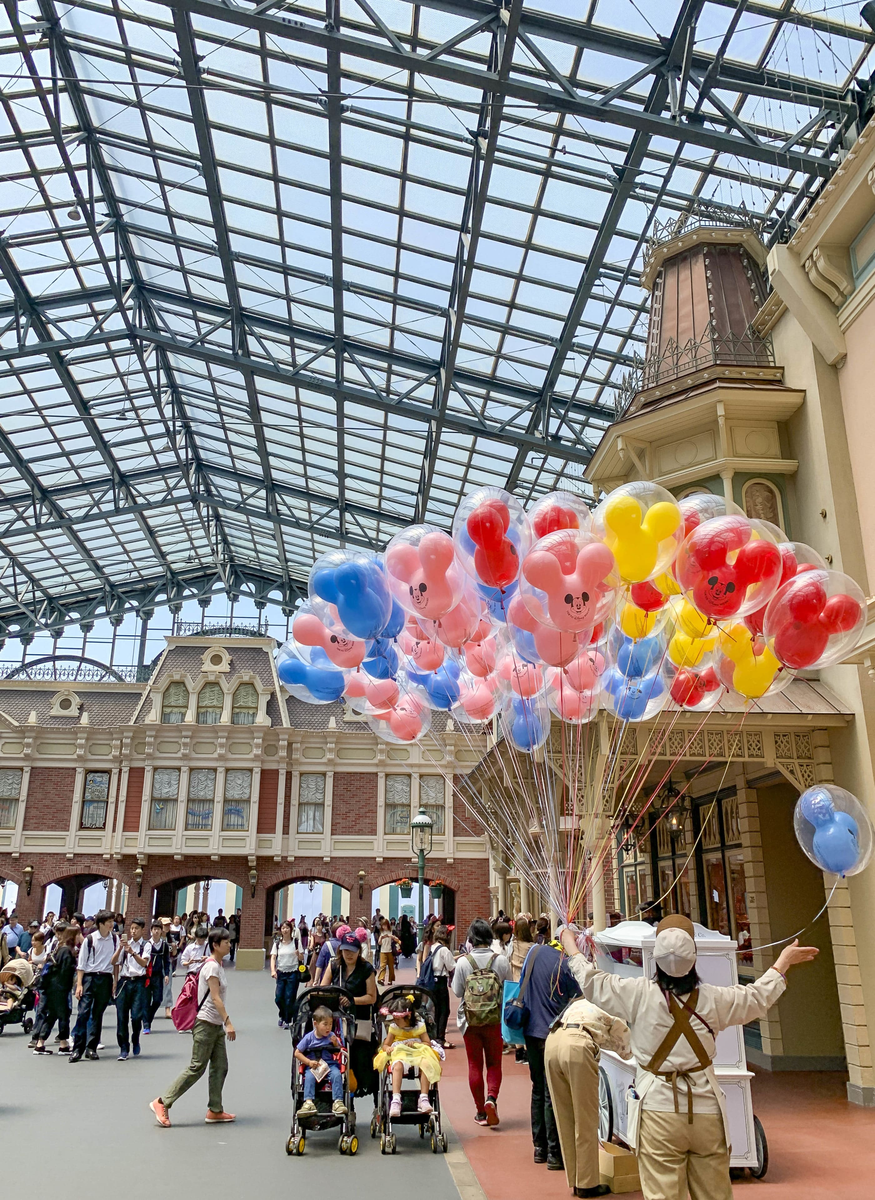 Mickey Mouse balloons for sale at the World Bazaar entrance to Tokyo Disneyland, one of the top things to do in Tokyo with kids.