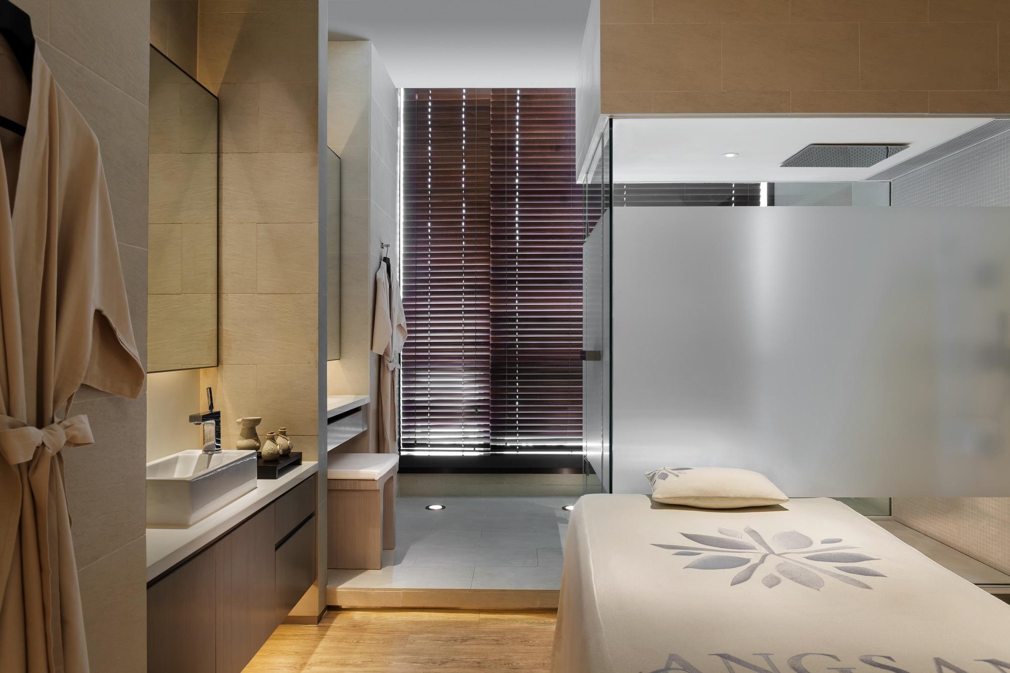 A single treatment room interior at Angsana Spa inside Hotel Icon Hong Kong.
