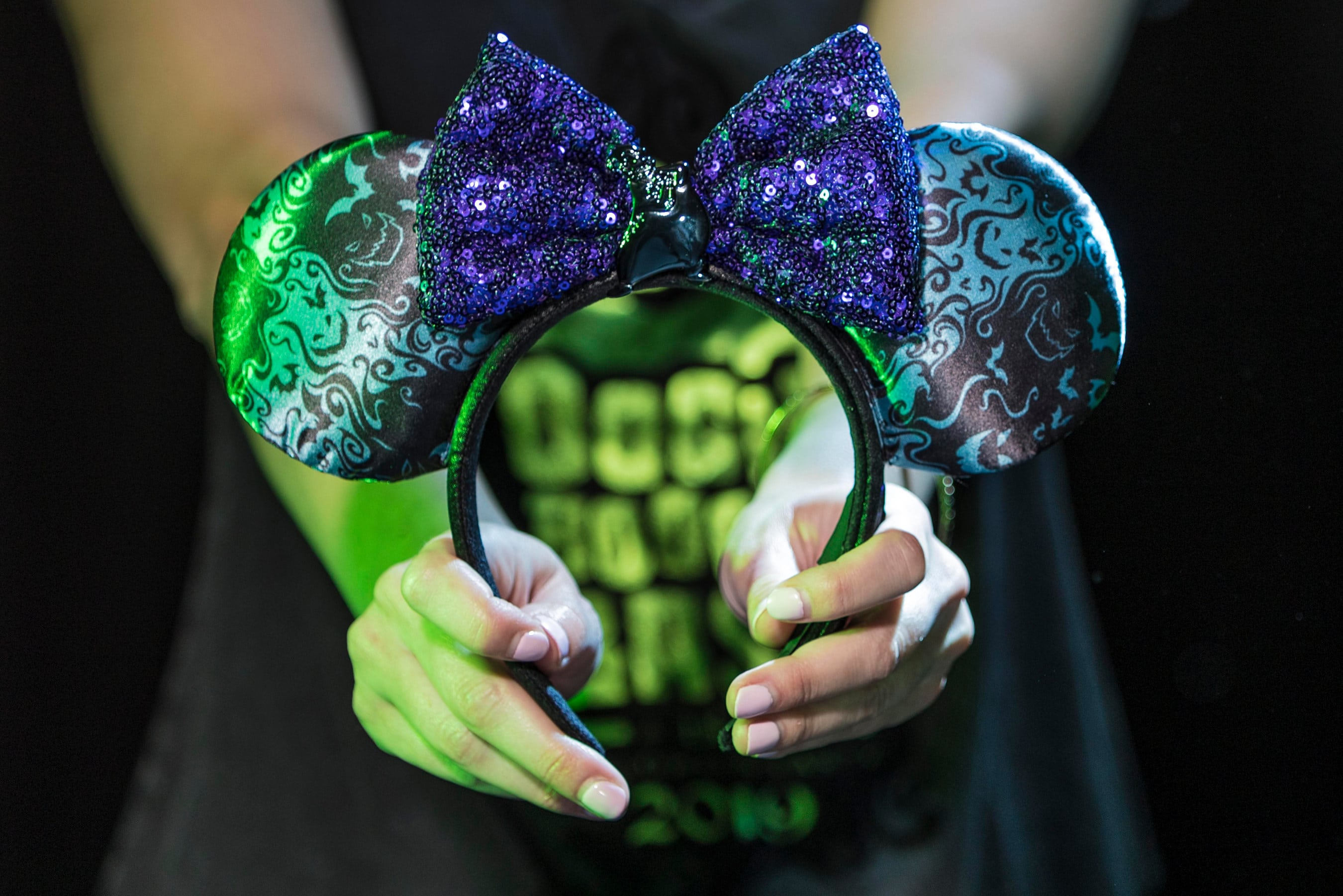 An Oogie Boogie Bash Mickey ears headband with purple sequined bow.