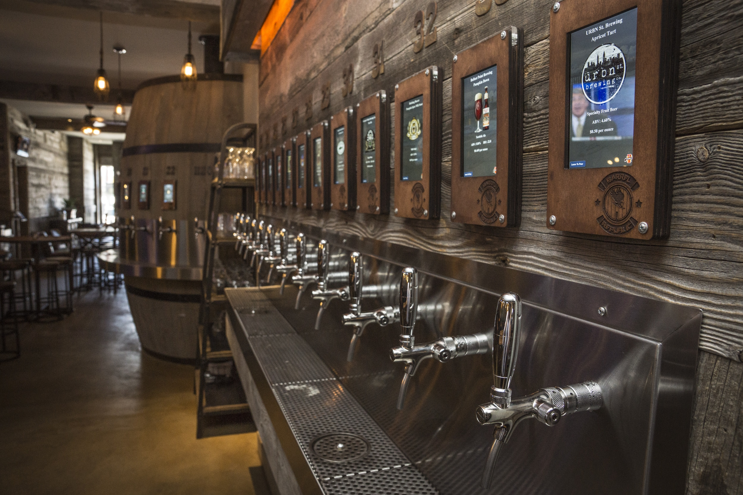 Side view of some of the 40 taps guests can pull from while sampling beer.
