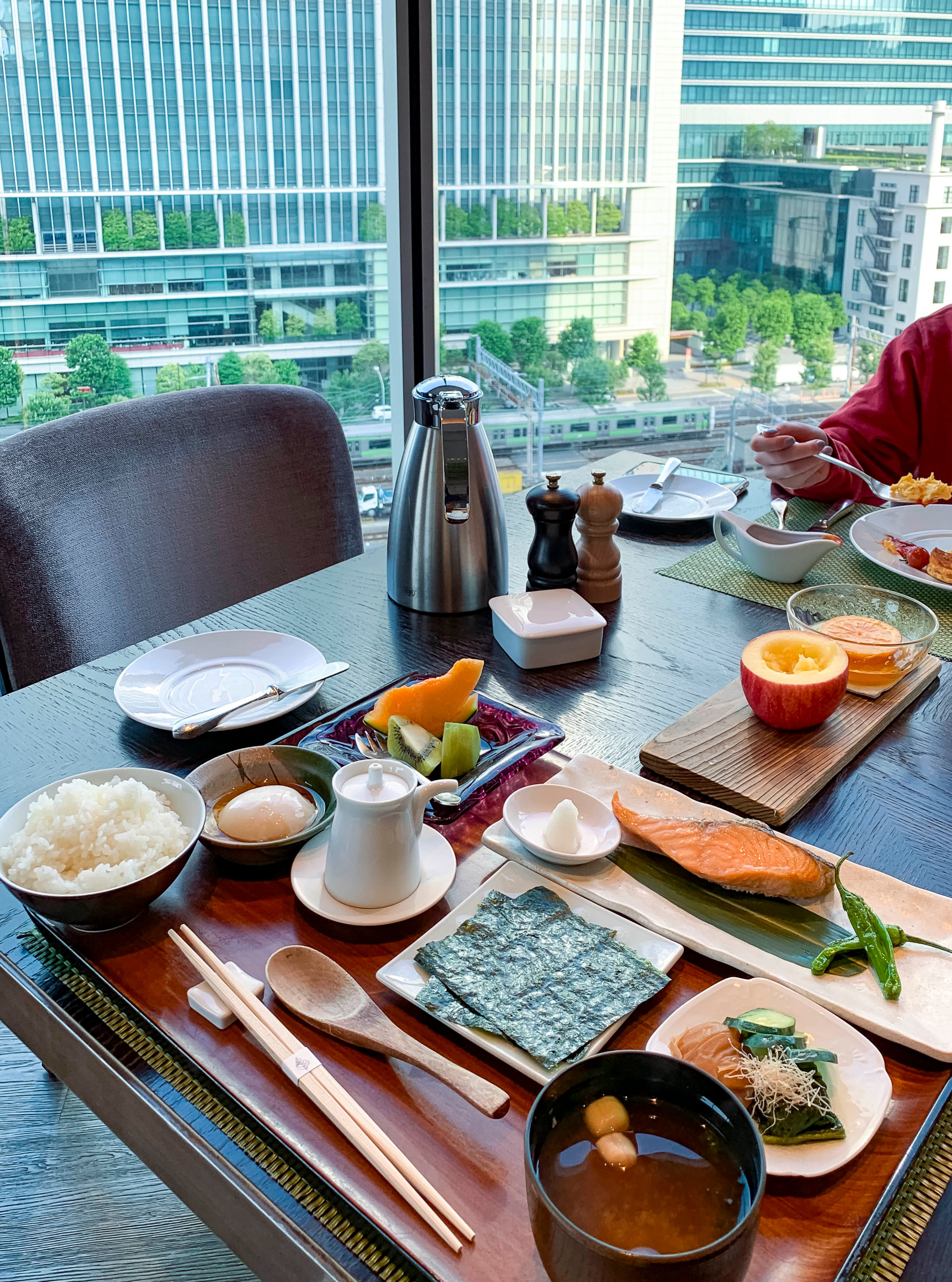 Japanese breakfast served with a view at Four Seasons Hotel Tokyo at Marunouchi, our favorite luxury hotel in the city.