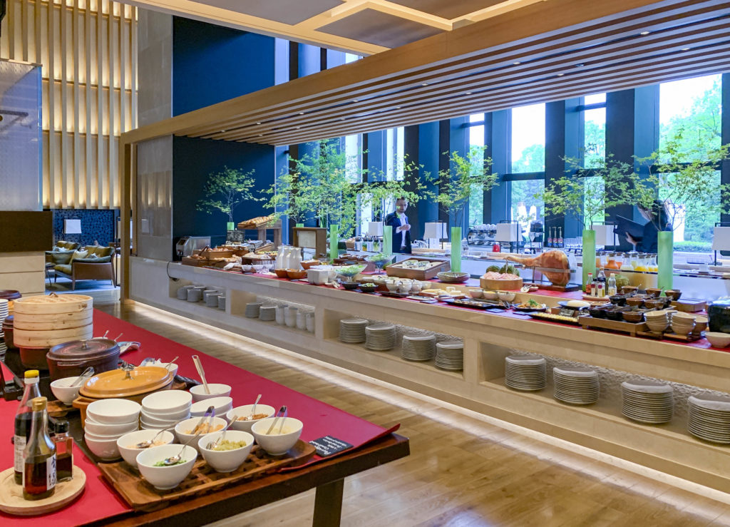 A wide shot of one side of the long buffet counter (there is mort on the other side) at Four Seasons Kyoto.